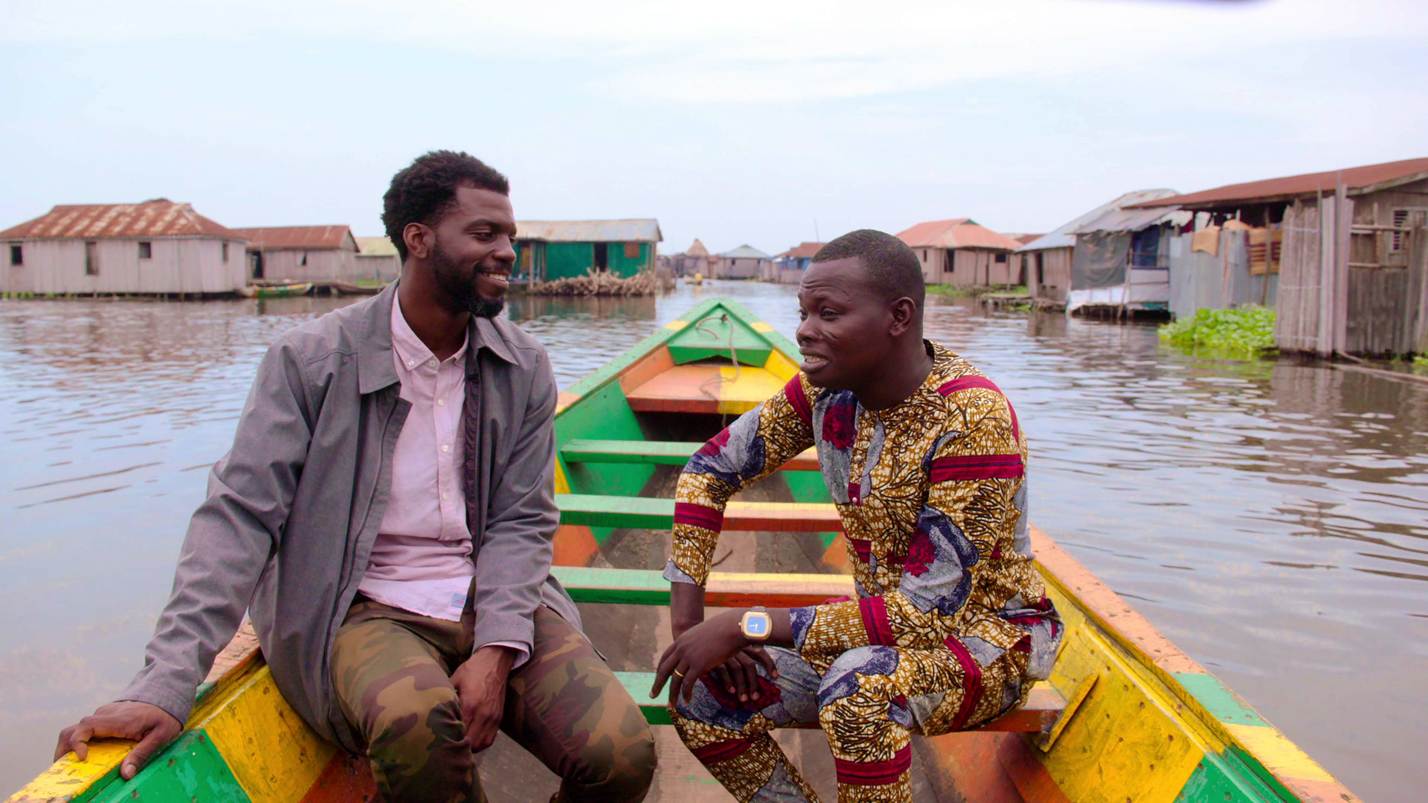 Eric Kiki and Stephen Satterfield on a boat in Ganvié, a lake village in Benin, Africa