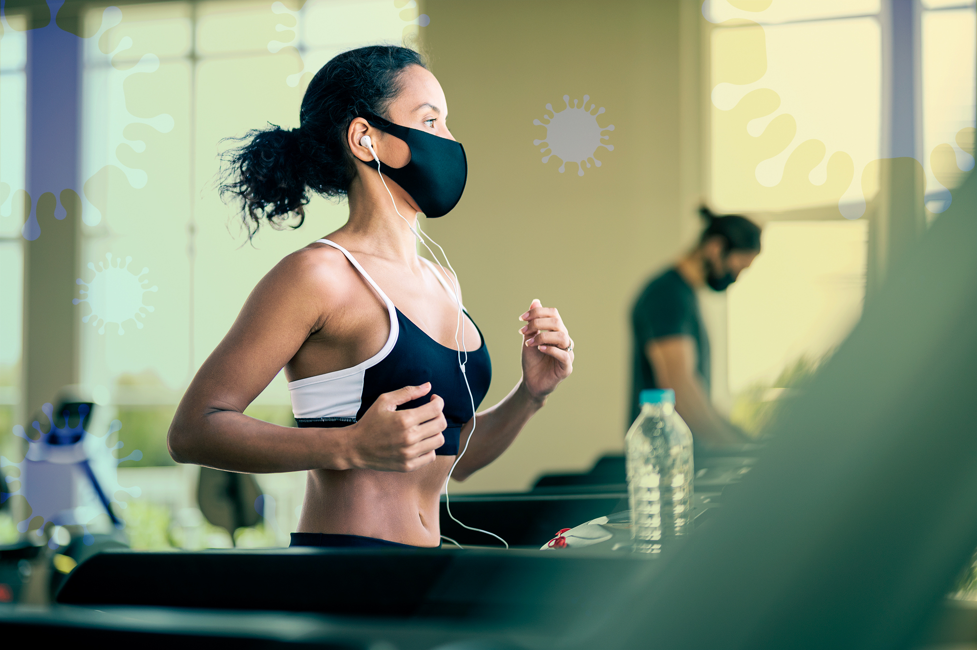 Athlete workout exercise at gym after pandemic reopening. They are running on treadmill and wearing a protective face mask