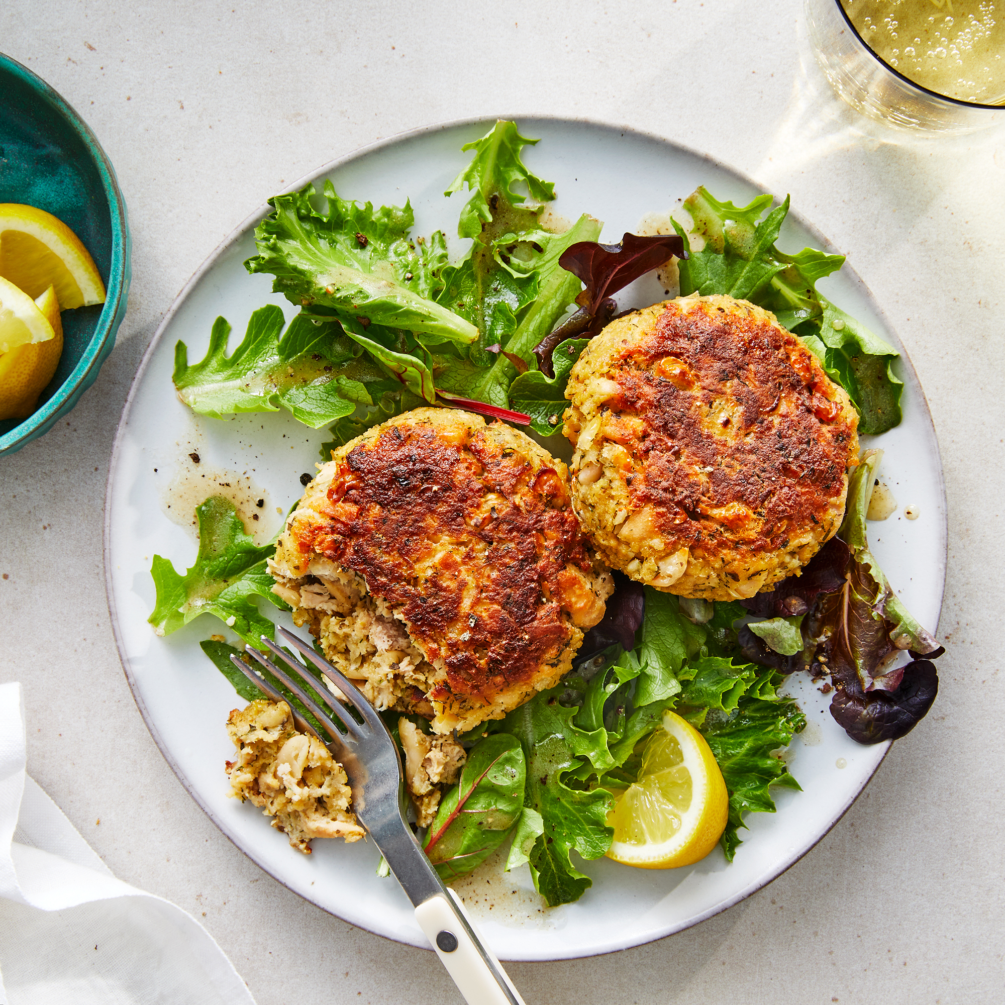 Easy Herby Tuna Cakes over Greens