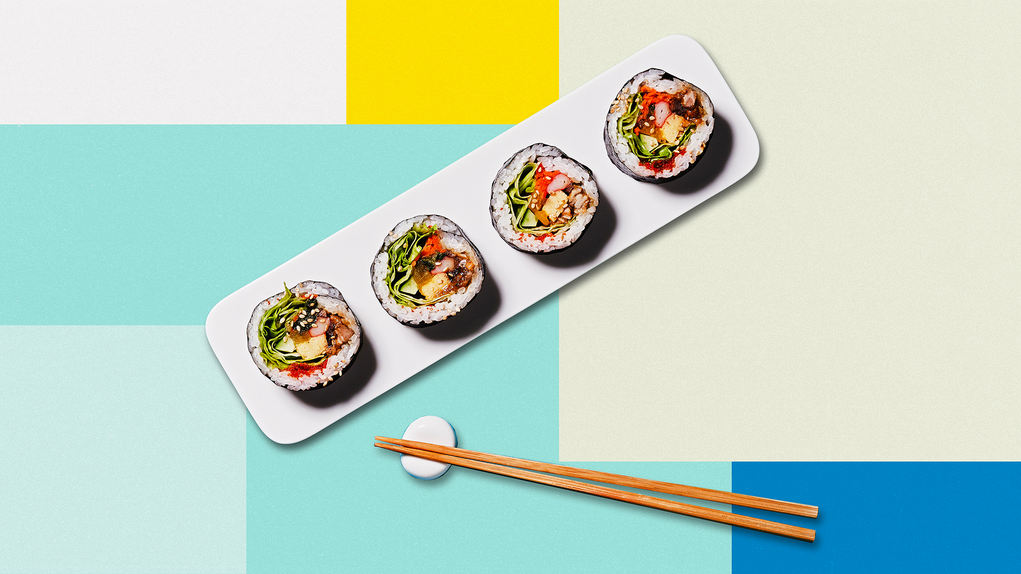 Sushi roll and chopsticks on a designed background