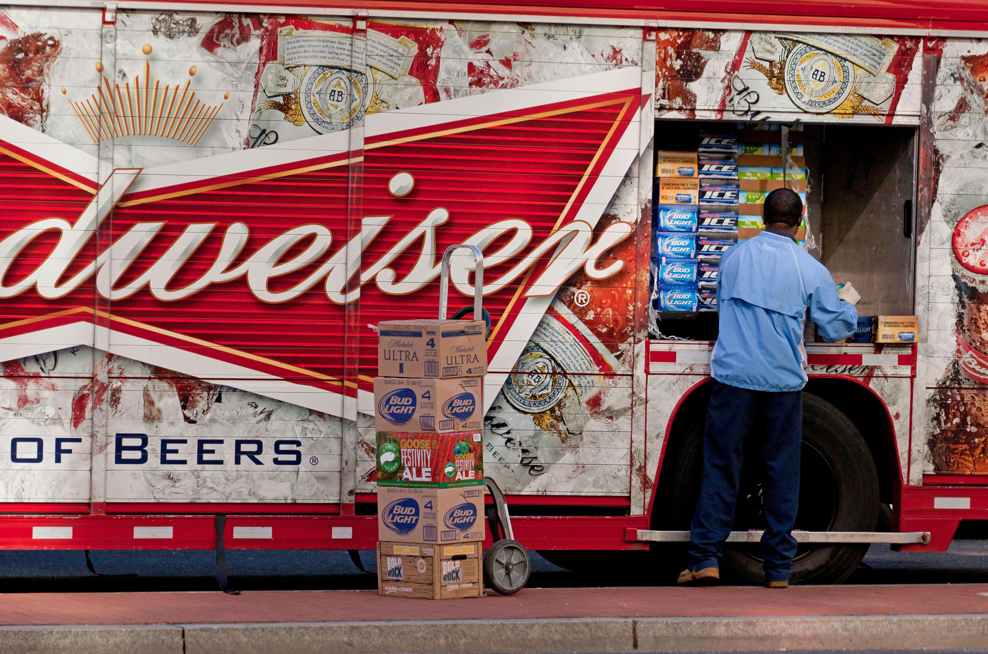 a Budweiser truck delivering cases of beer
