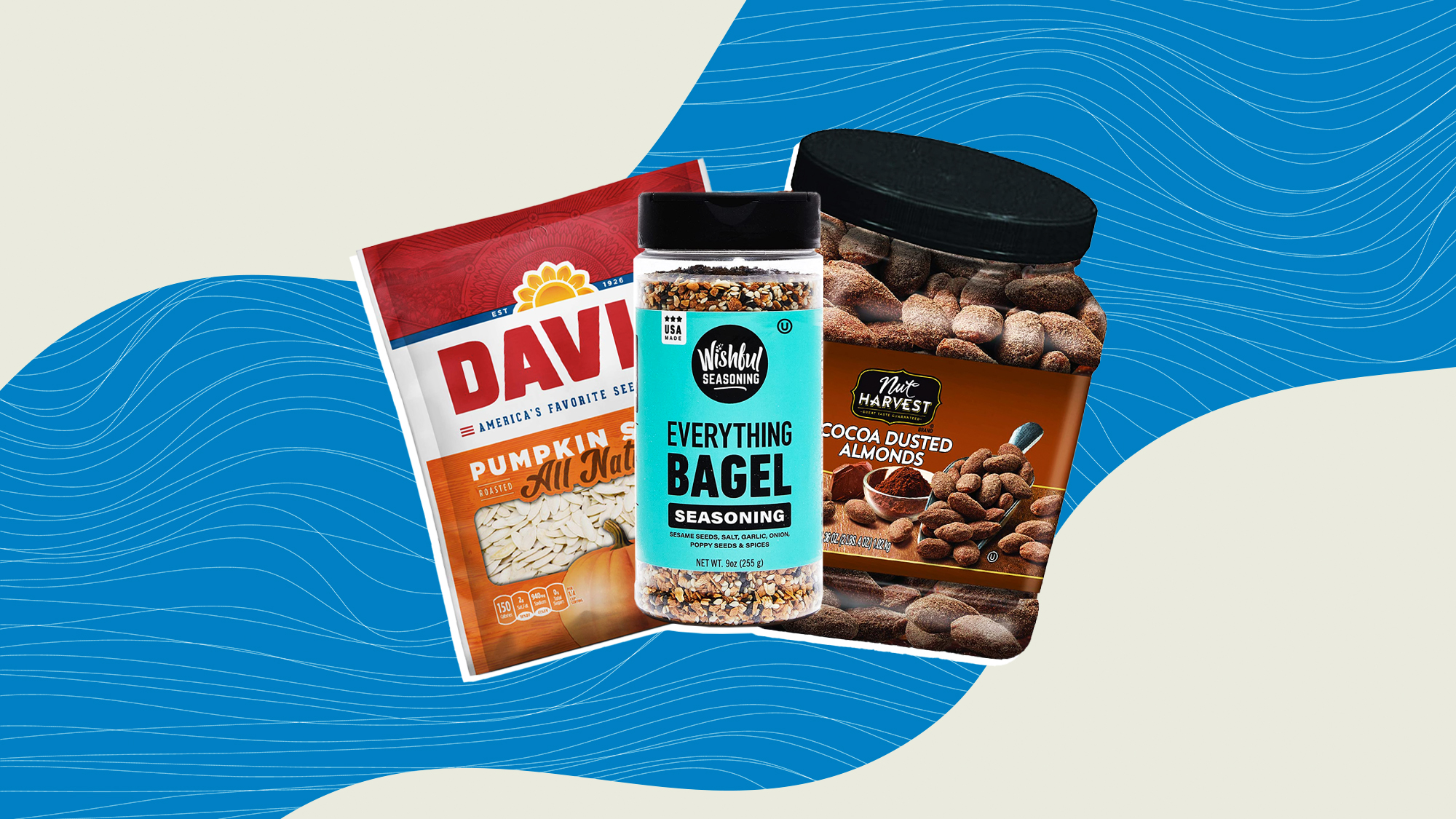 3 food products including Wishful Seasoning Everything Bagel Seasoning, Chocolate covered almonds and Pumpkin seeds on a designed background