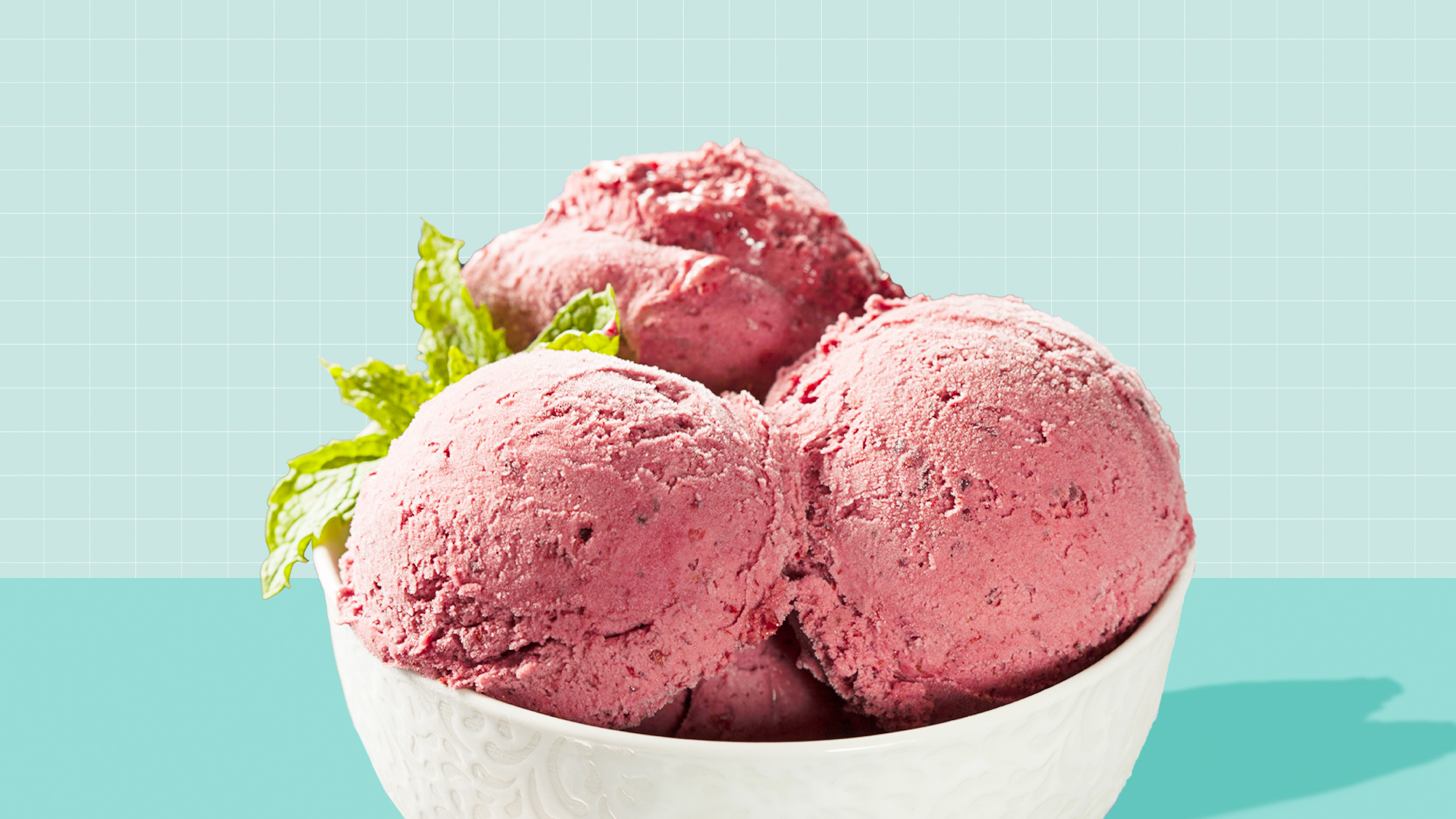 a bowel of berry sorbet on a designed background
