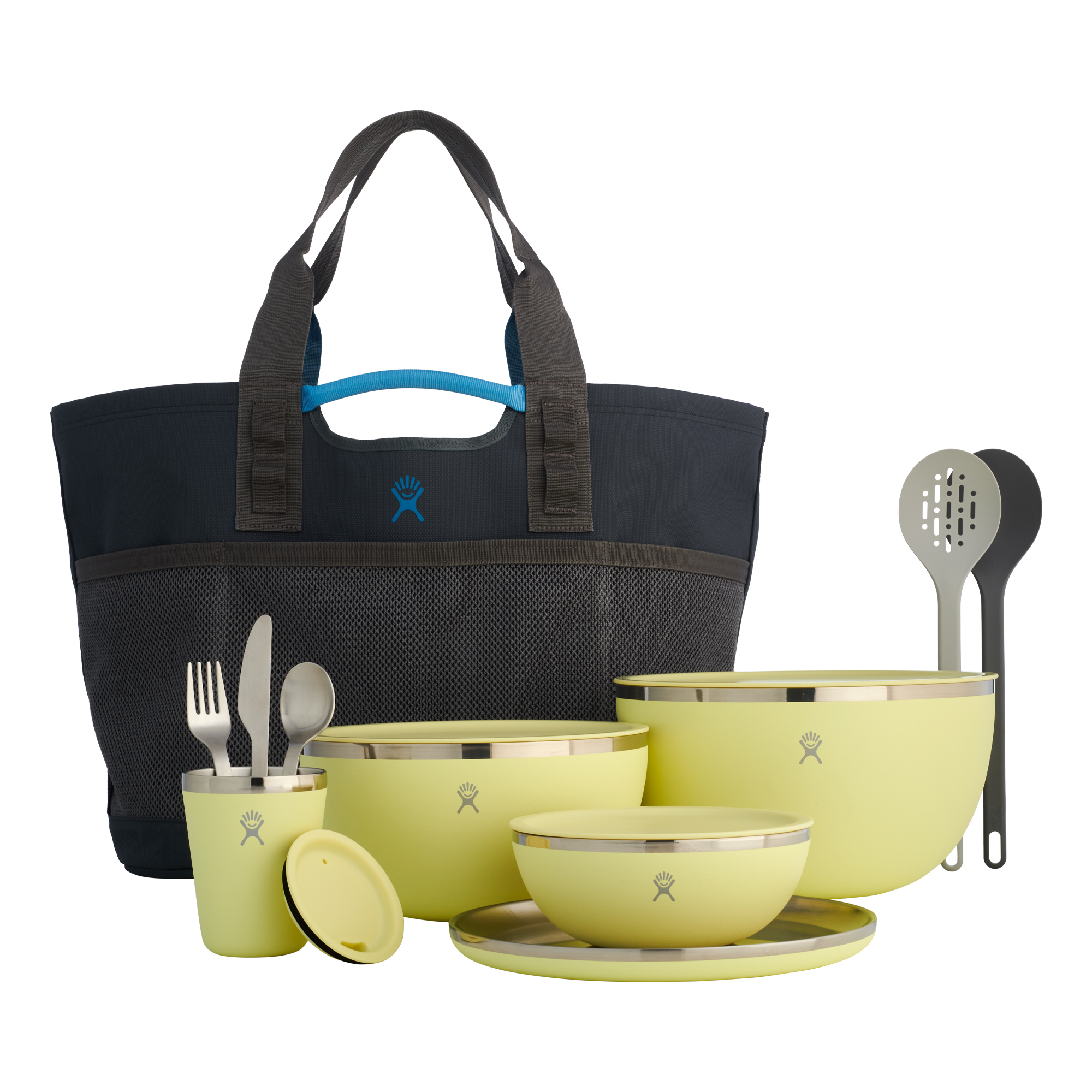 gray tote back and set of yellow bowls and kitchen utensils together on a white background