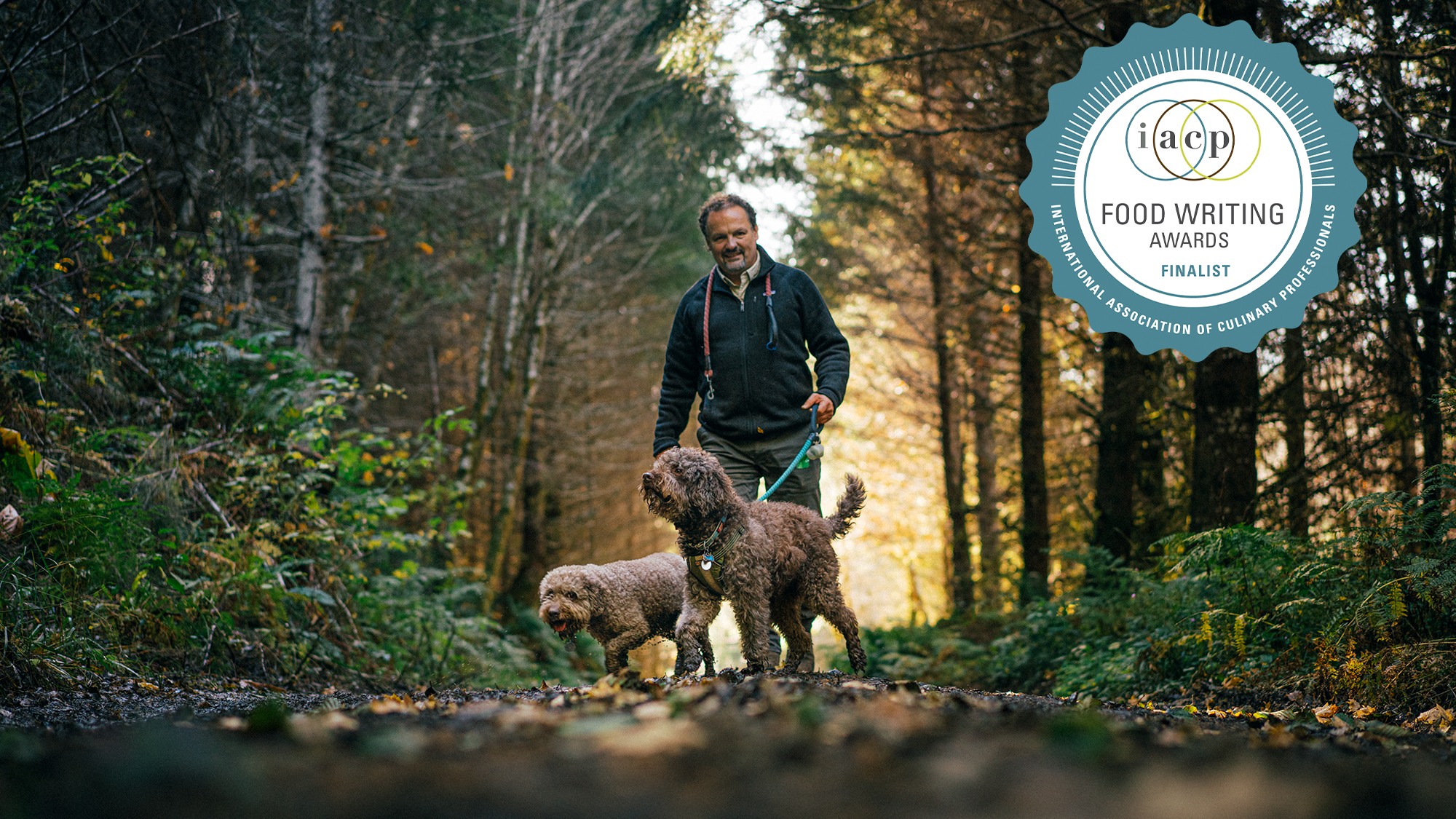 Charles Lefevre and his keen-nosed dogs, Mocha and Dante, hunt for truffles on an old logging road in the Oregon woods, where the fungi grow underneath Douglas fir trees.