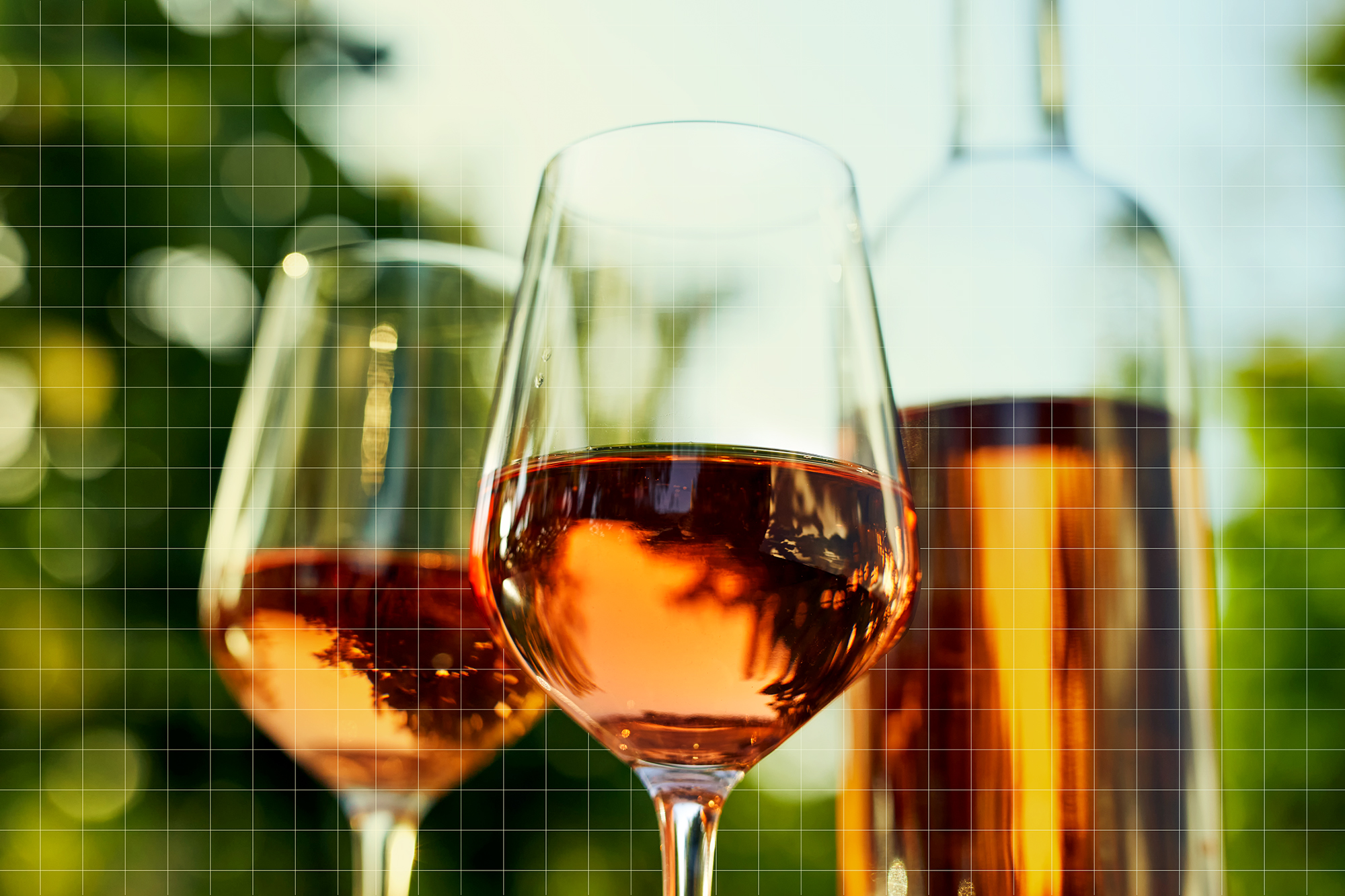 Two glasses of rose wine and a bottle, close-up