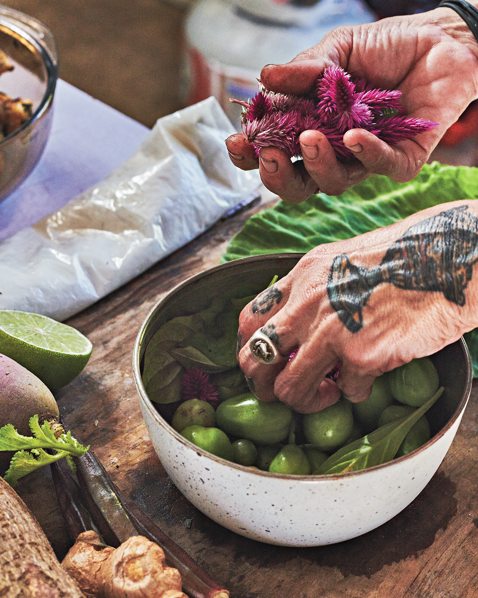 close up of hands grabbing produce from a bowl