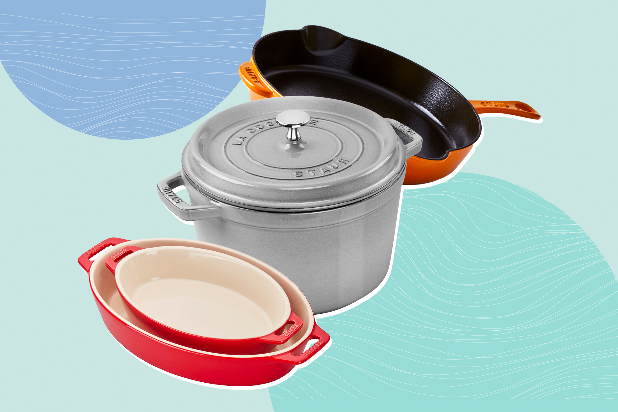 3 Staub cast iron pots and pans on a designed background