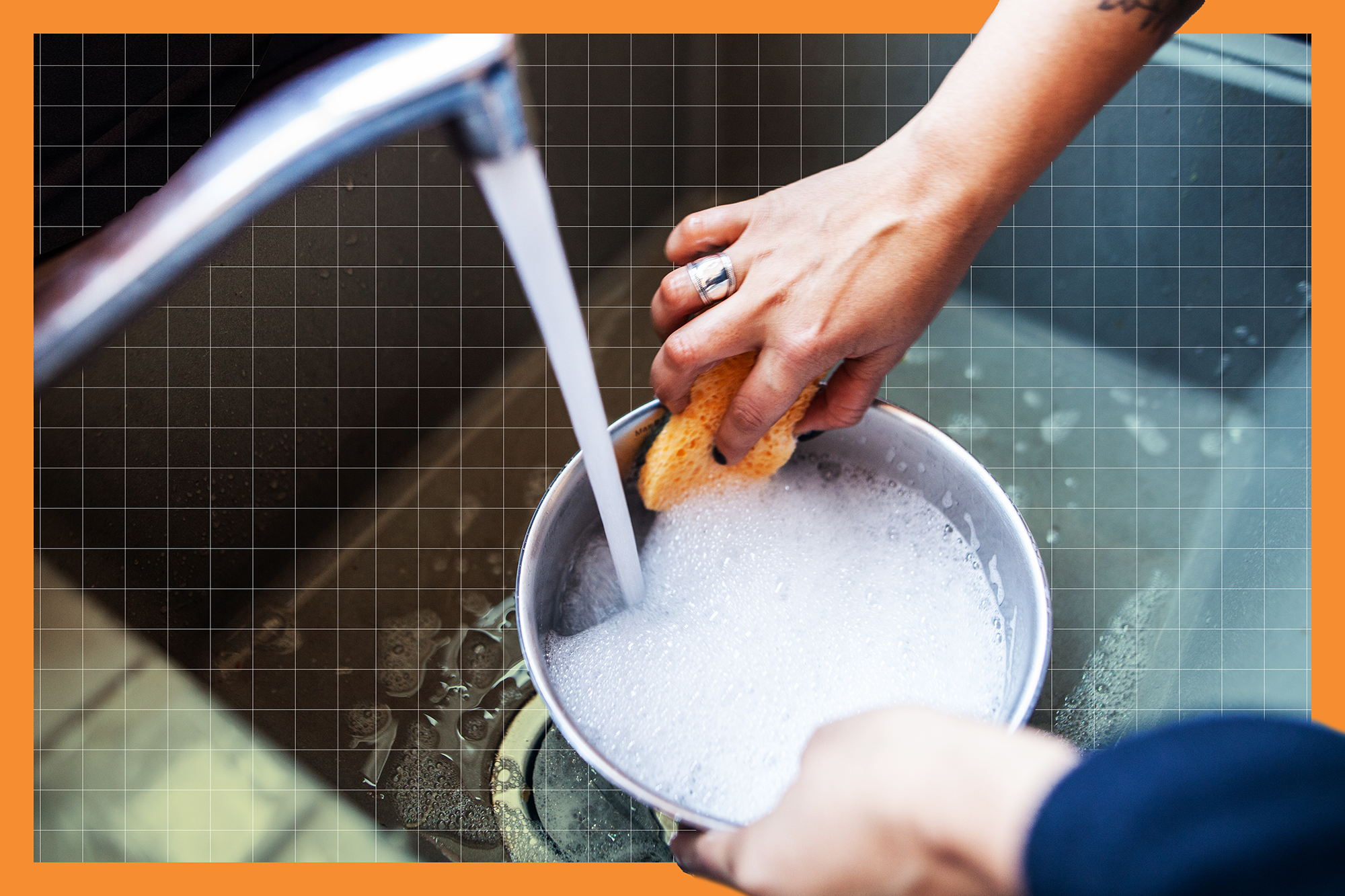 woman's hands washing a pot in the sink