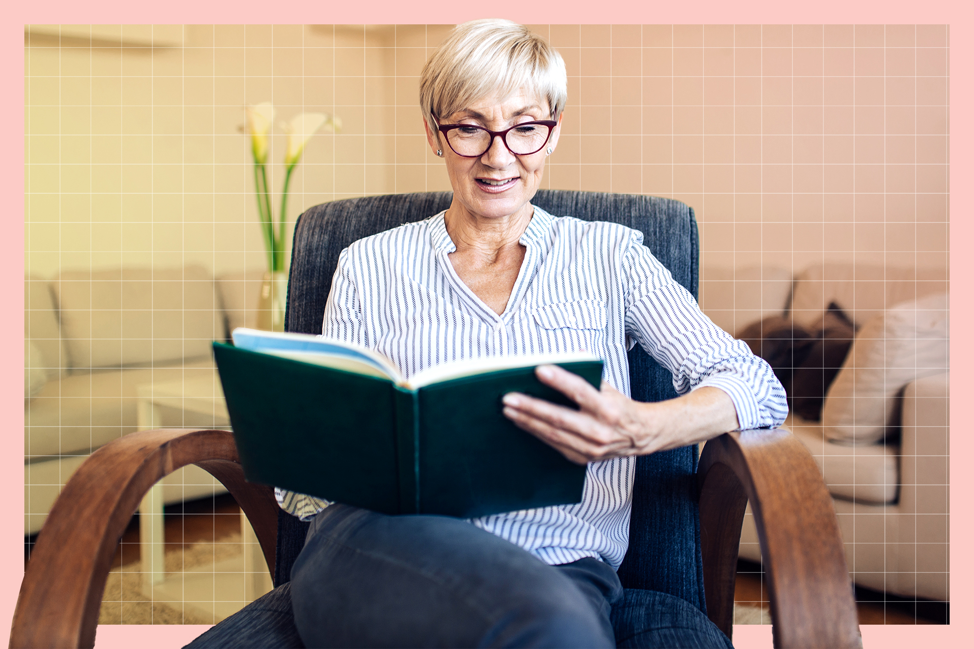 Portrait of a senior woman reading a book at home