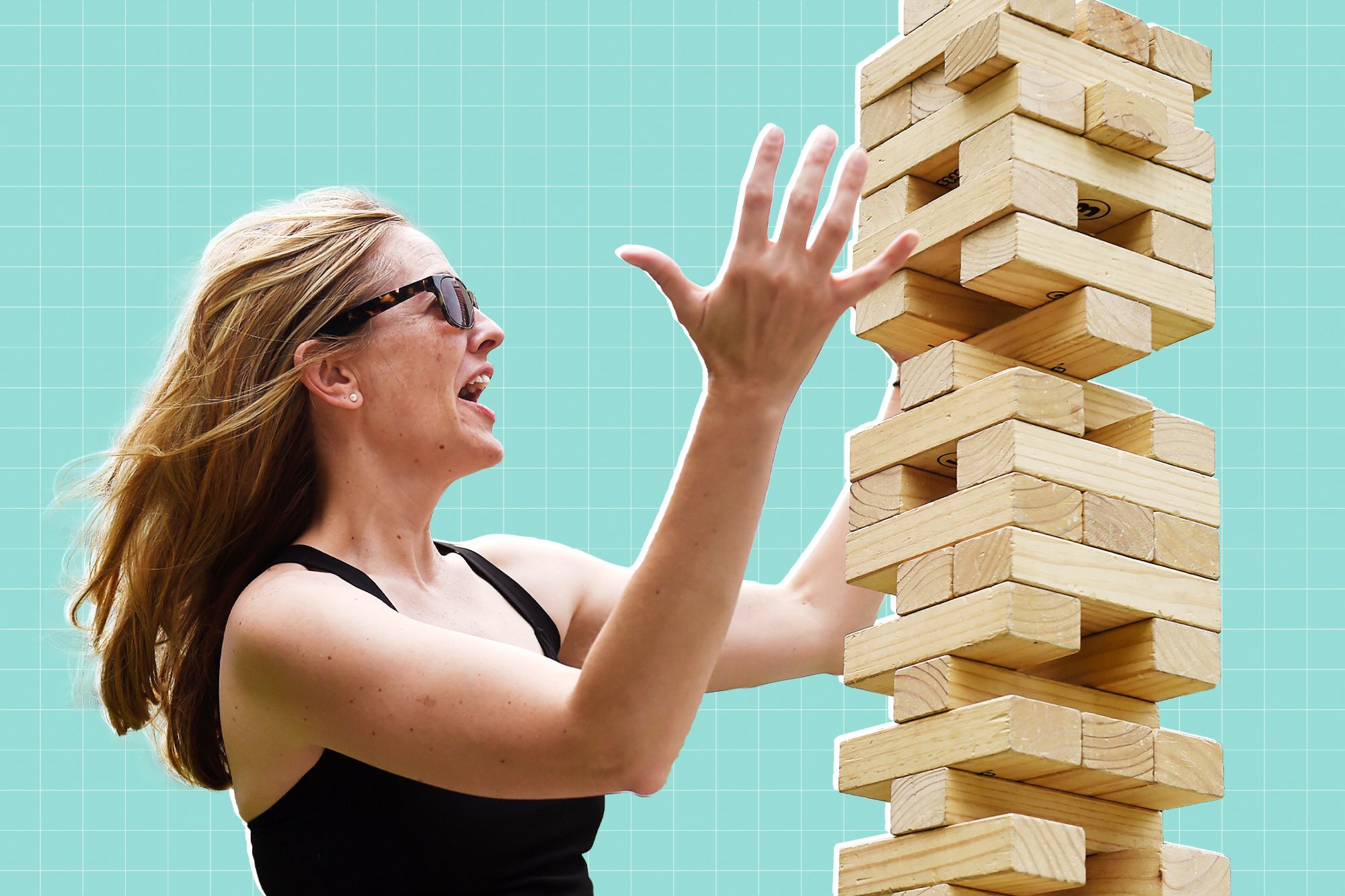 Woman playing a large outdoor Jenga game