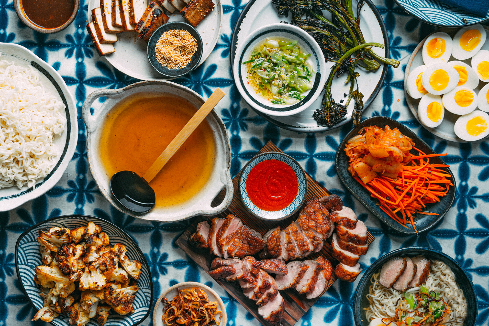 A table full of plated ramen ingredients