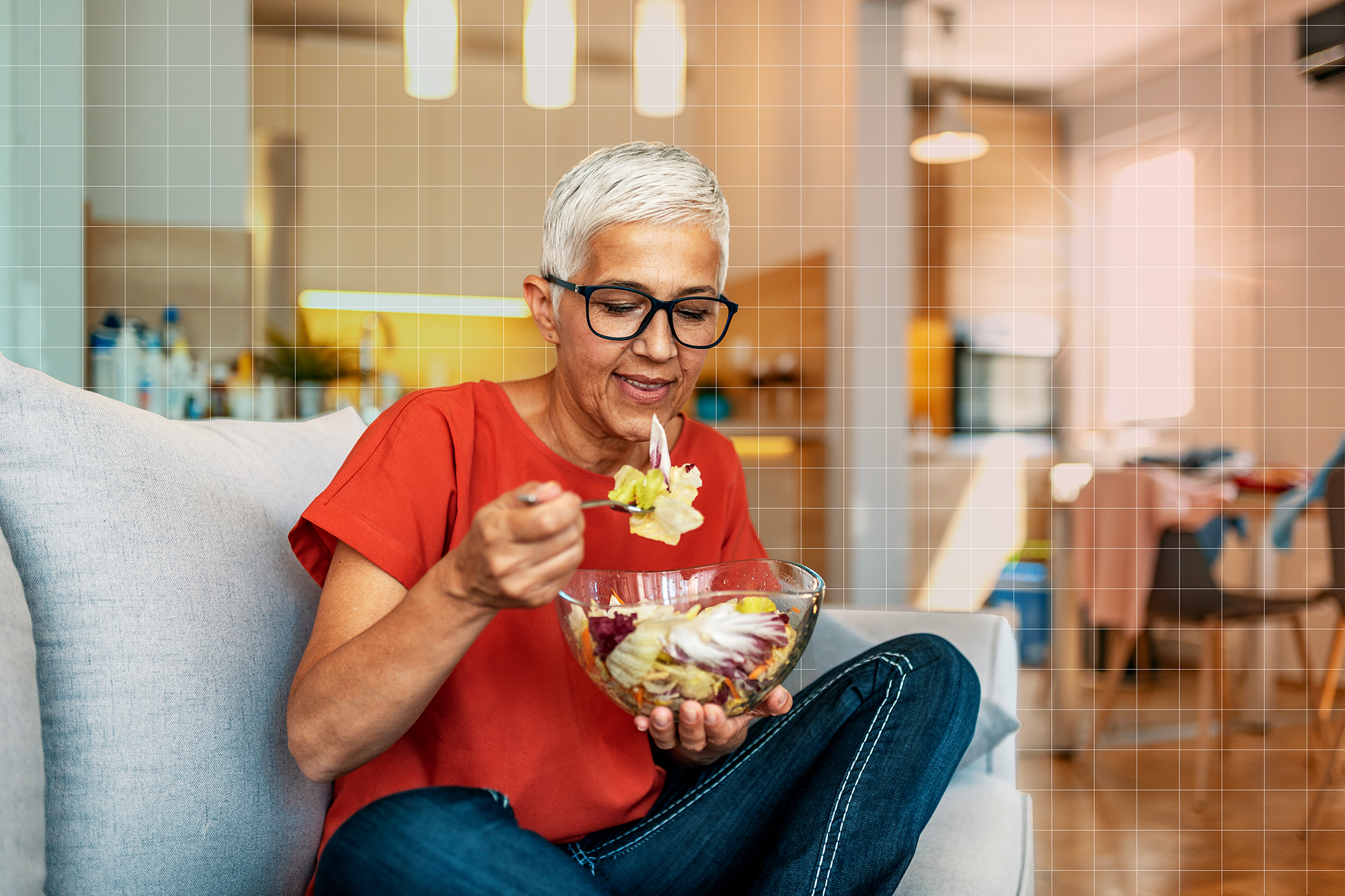 Smiling woman eating vegetable salad at home