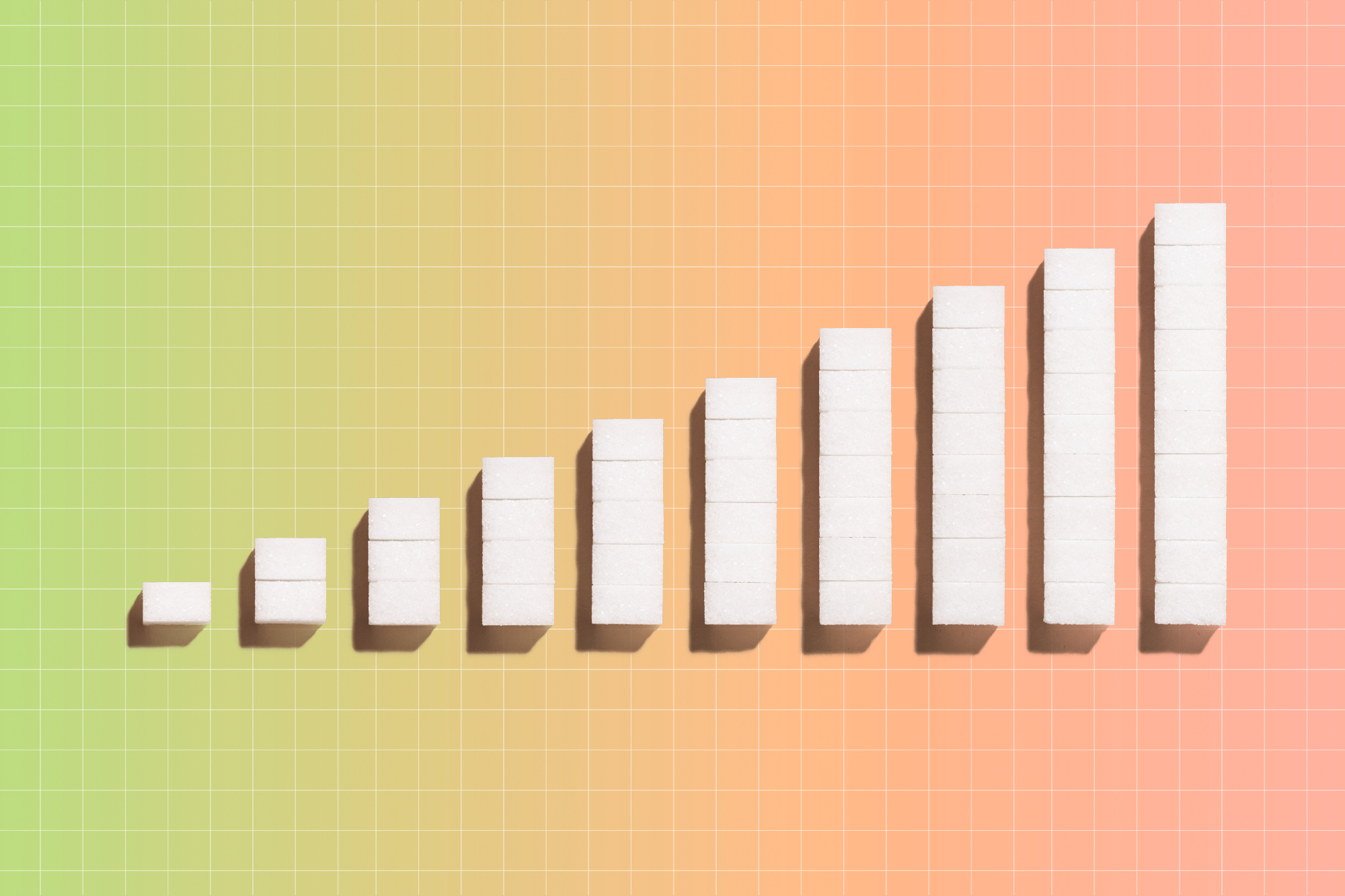 Sugar cubes in a increasing bar graph with a color gradient in the background