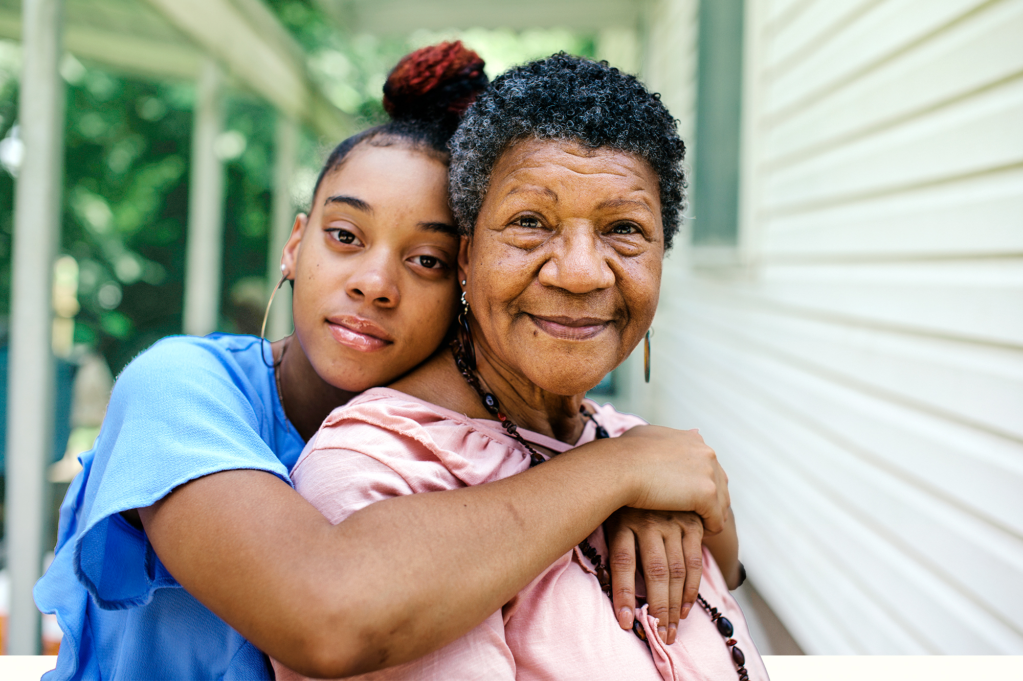 Portrait of grandmother with teenager granddaughter