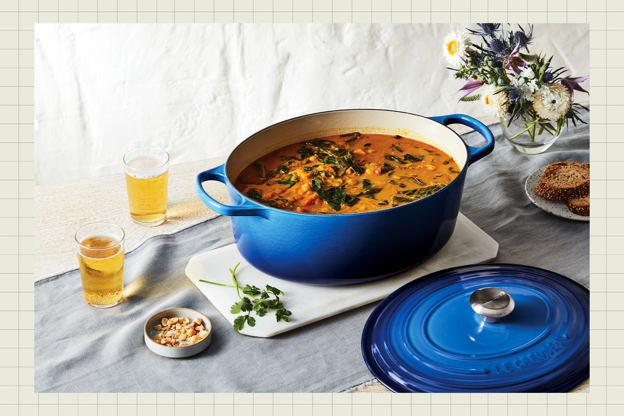 Le Creuset dutch oven on a table with soup in it