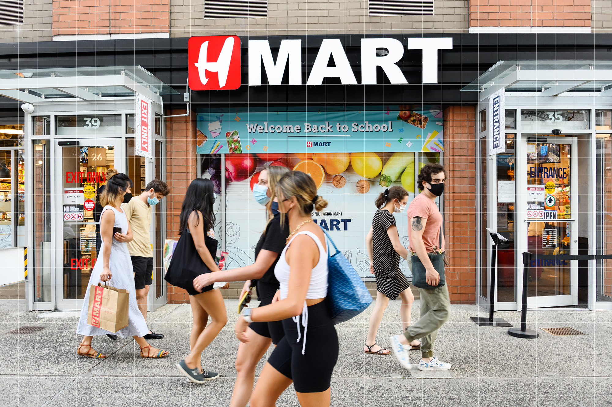People walking in front of H-Mart
