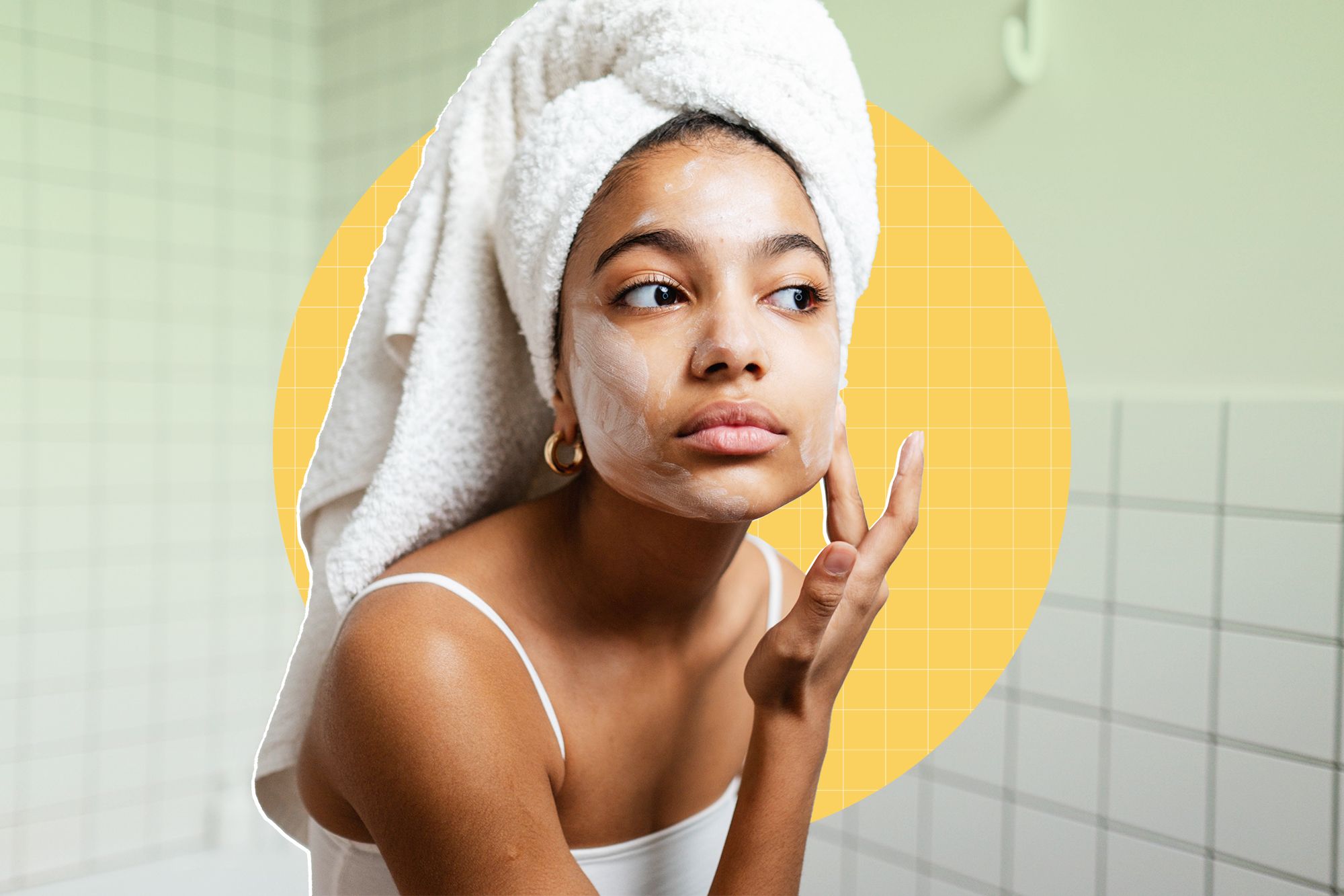a woman putting face moisturizer on in the bathroom