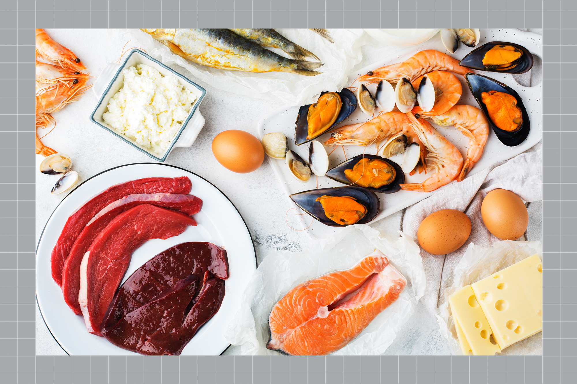 Assortment of healthy vitamin B12, cobalamin source food on a designed background
