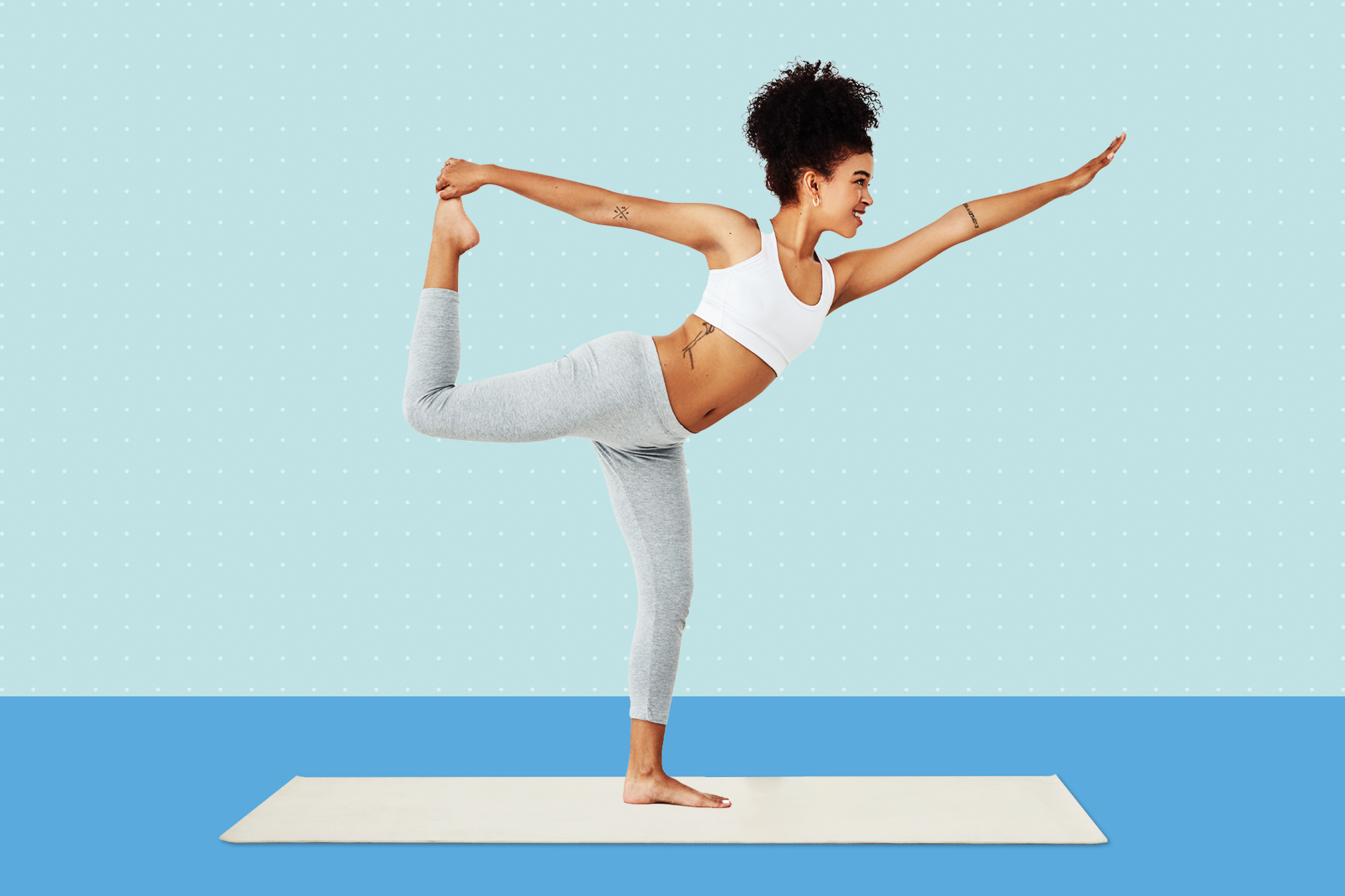A woman balancing on one foot while doing yoga on a designed background