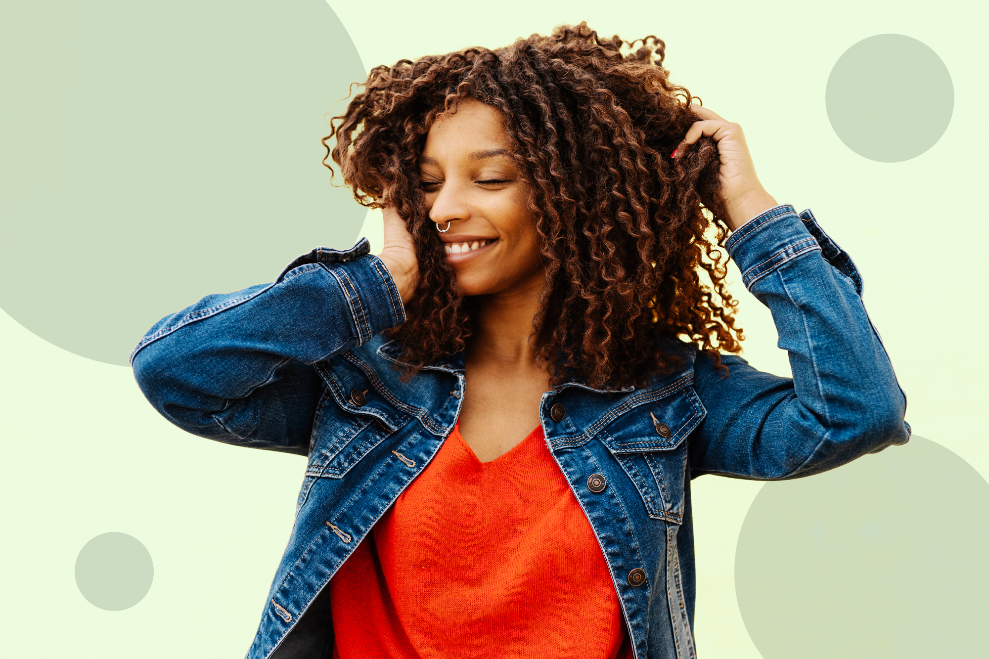 Aa woman flipping her hair on a designed background
