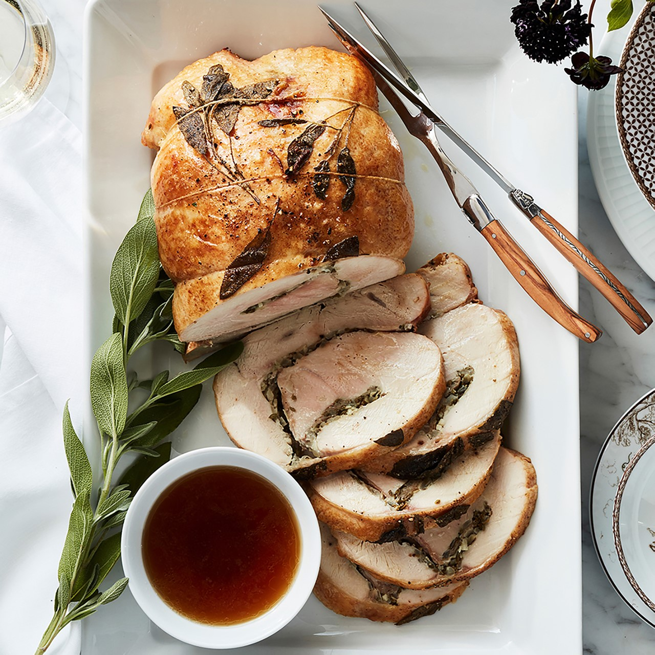 Turkey roulade and gravy on white plate