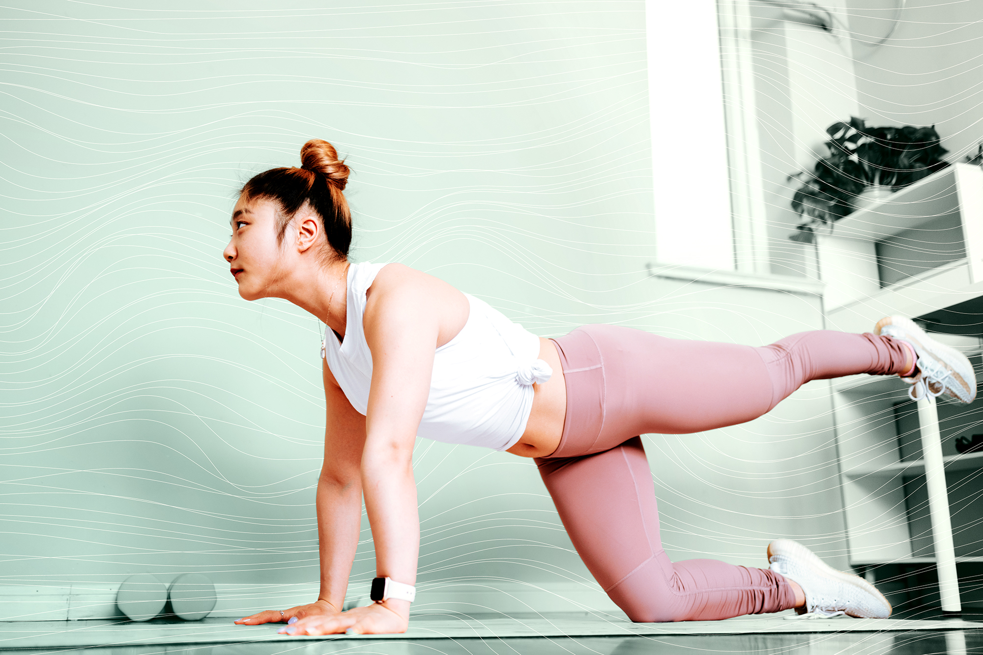 young woman practicing pilates at home