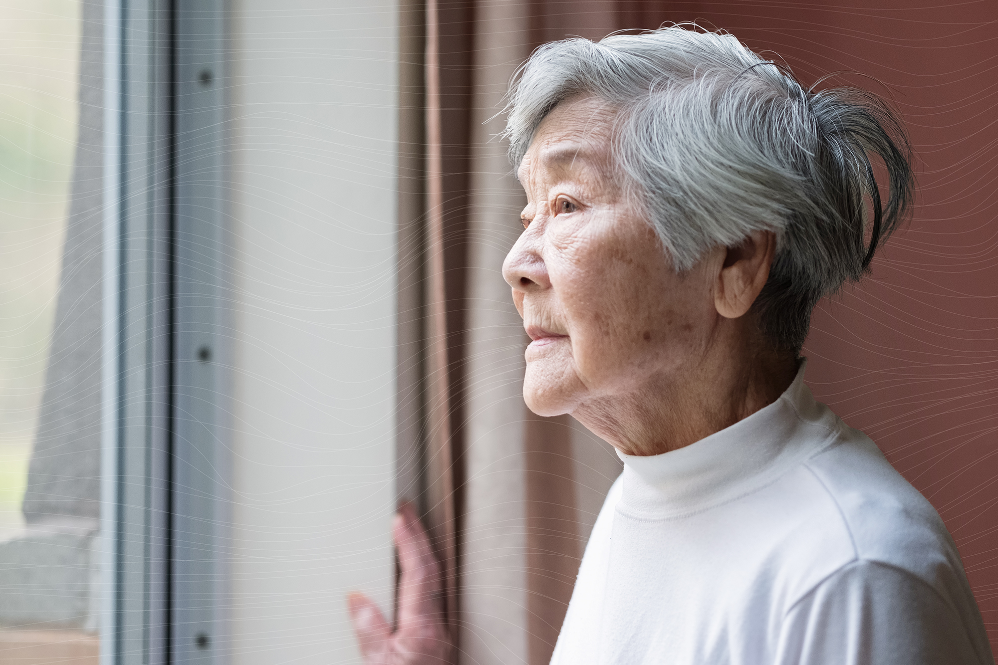 Serious Asian Senior Woman in 90s Looking Out of Window