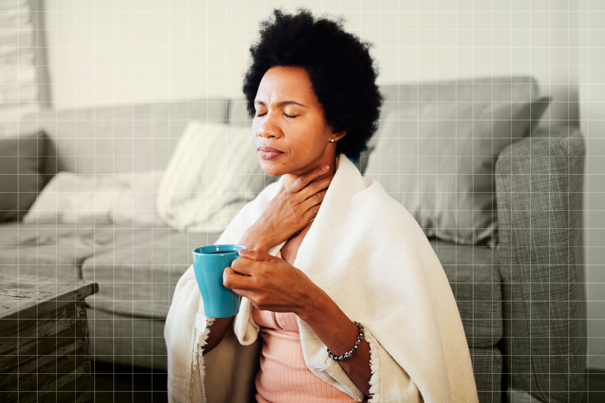 Sick woman with a sore throat staying at home