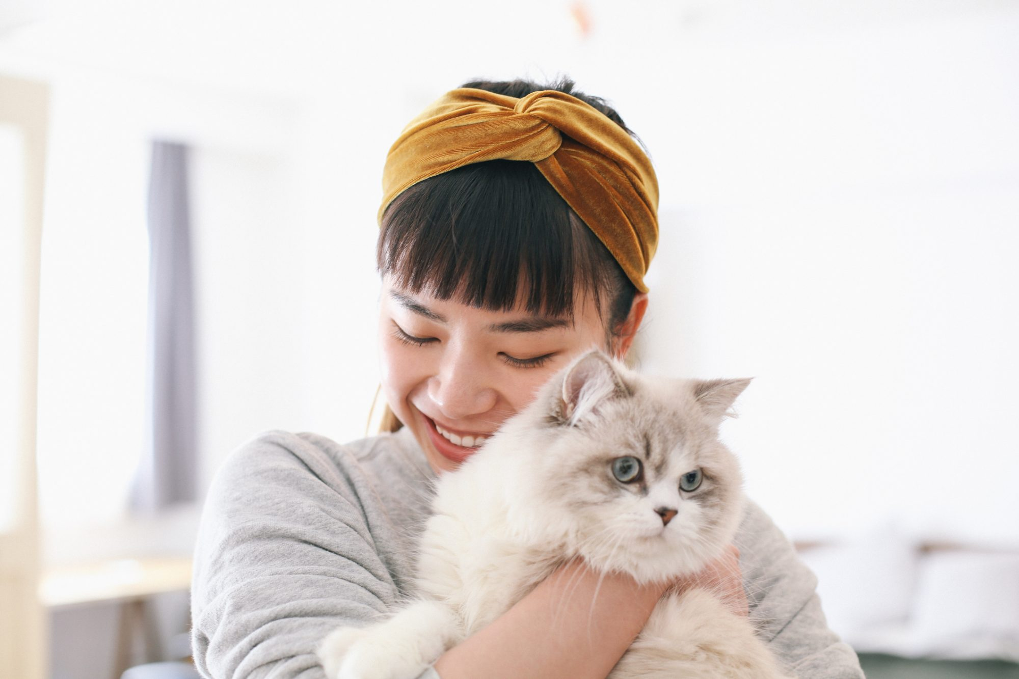 woman and cat snuggling