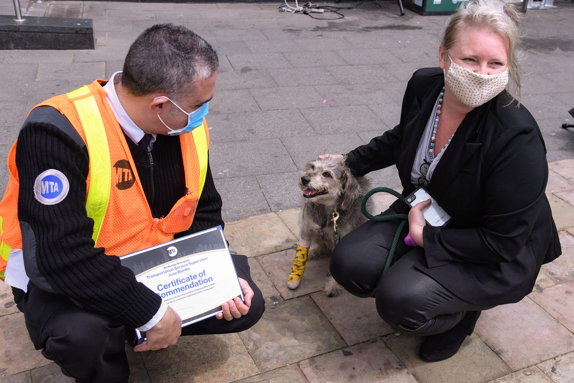 MTA Chief Customer Officer Sarah Meyer presented a certificate to Train Service Supervisor (TSS) Jose Bonilla at South Ferry Terminal on Tue., May 11, 2021, for his rescue of Lucy, a runaway dog, from the tracks on Saturday.