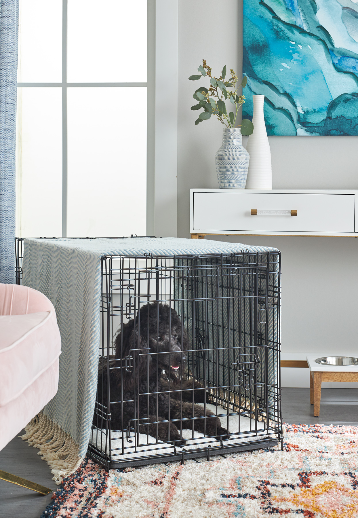 dog resting in metal dog crate