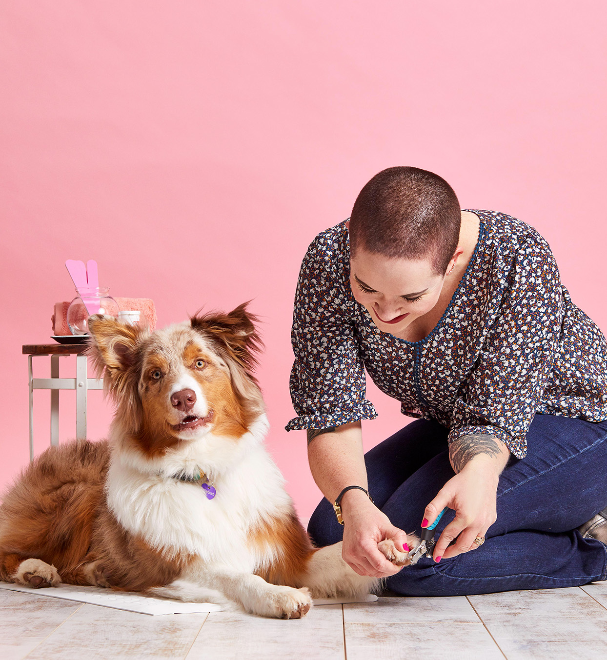 woman clipping dog's toenails
