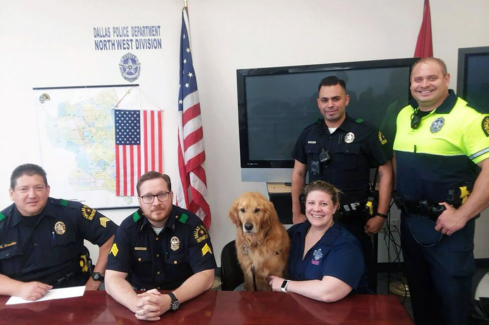 Therapy dog visits with police unit