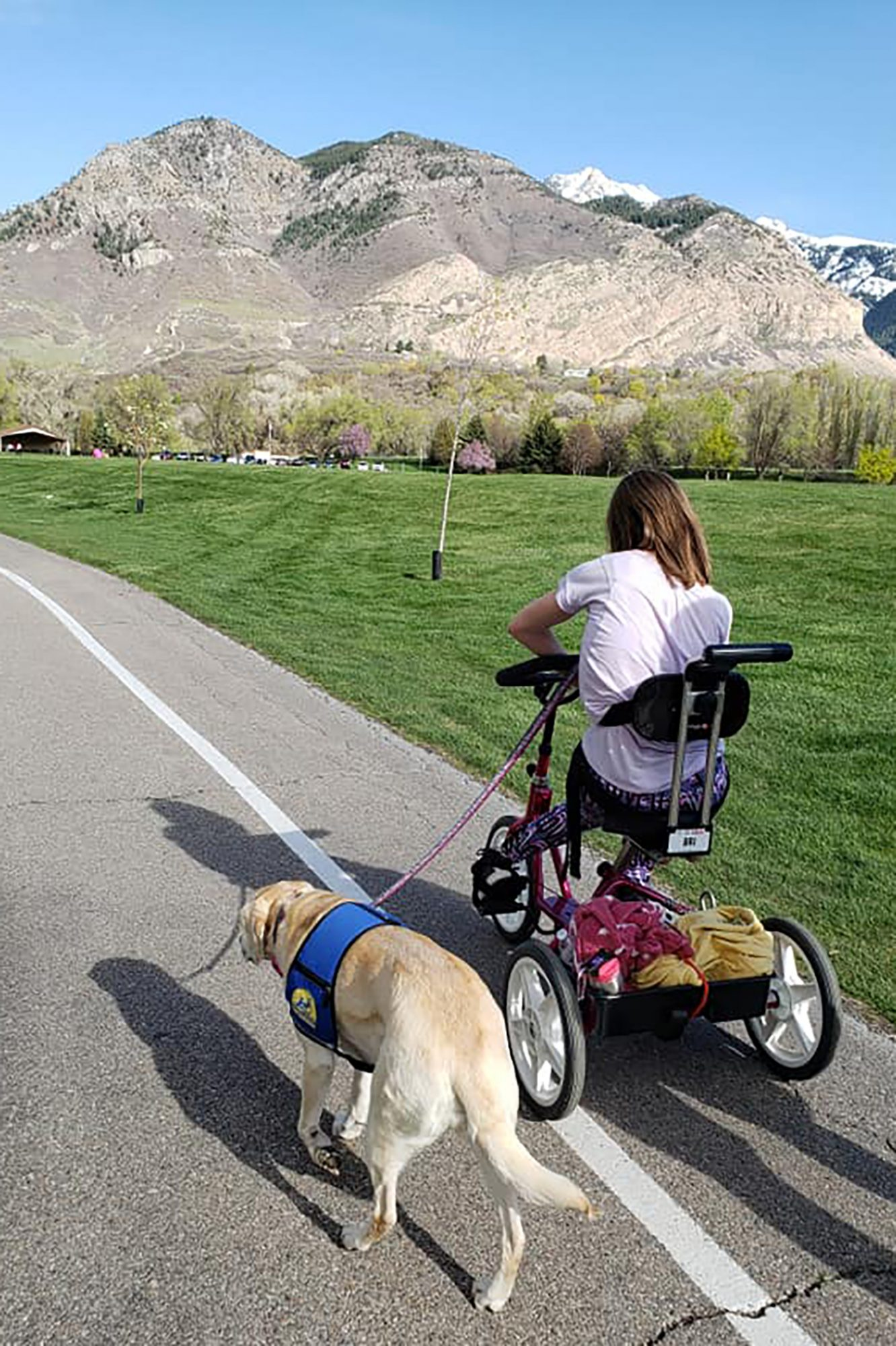 Brianna the handler walking service dog