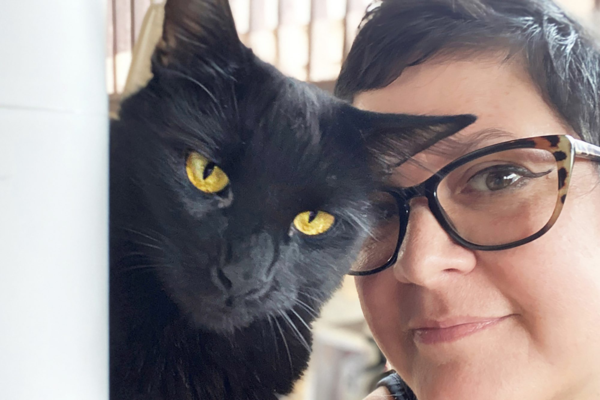 Emotional support cat and his owner Kate Benjamin