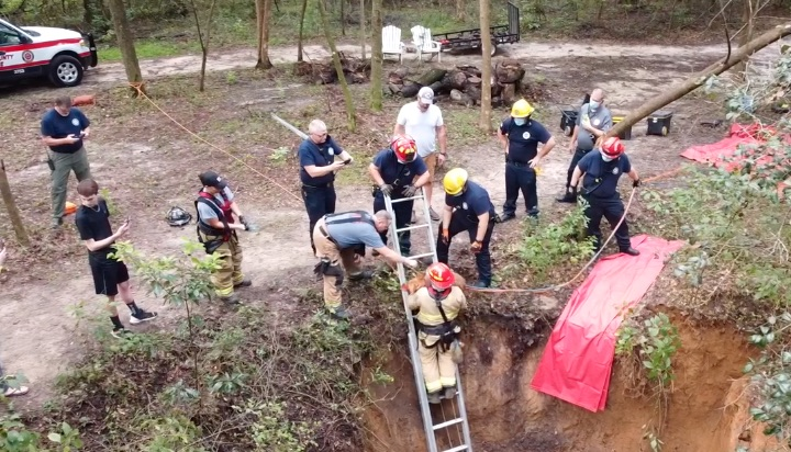 dog rescued from sinkhole