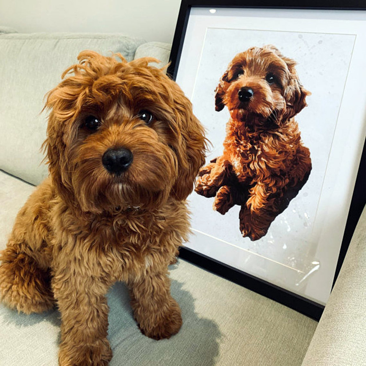 Puppy sits next to custom painted portrait of himself