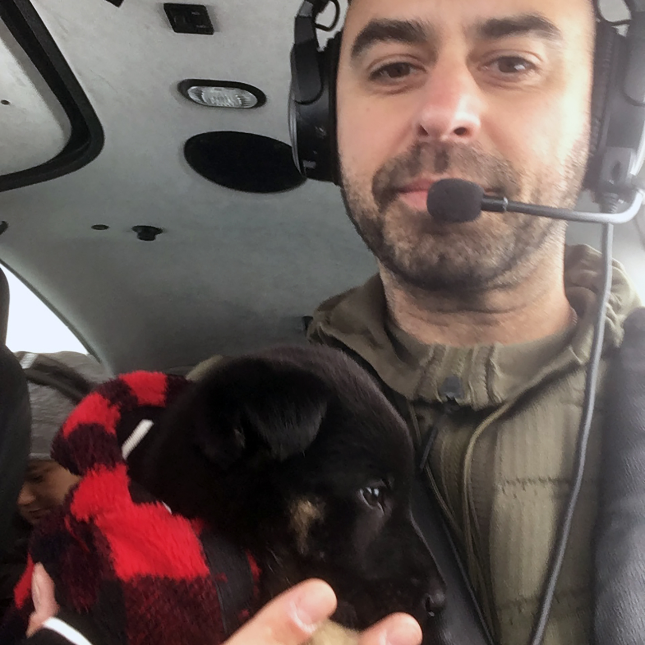 Eduard with puppy in cockpit