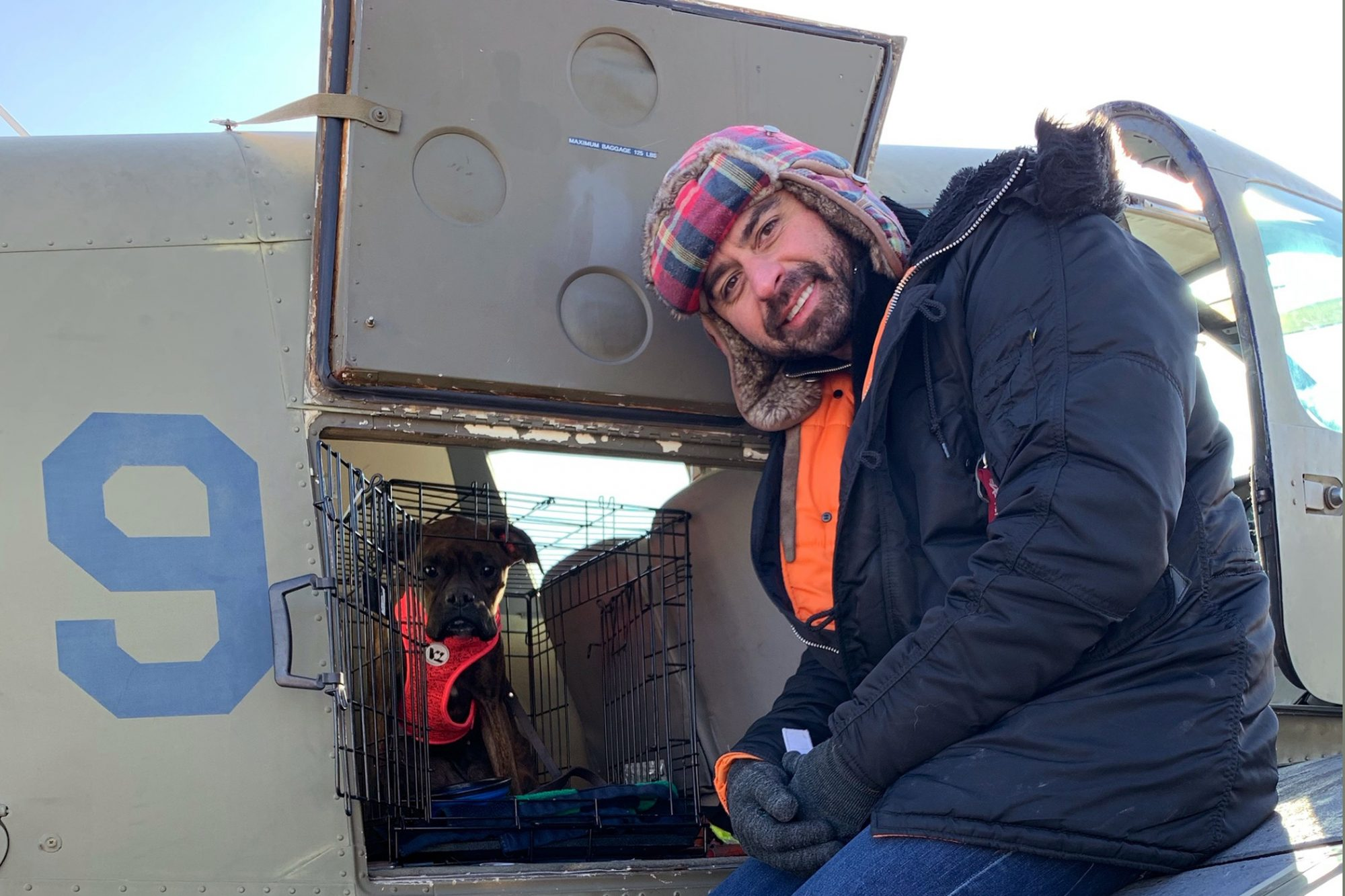 Eduard with rescue dog at plane door