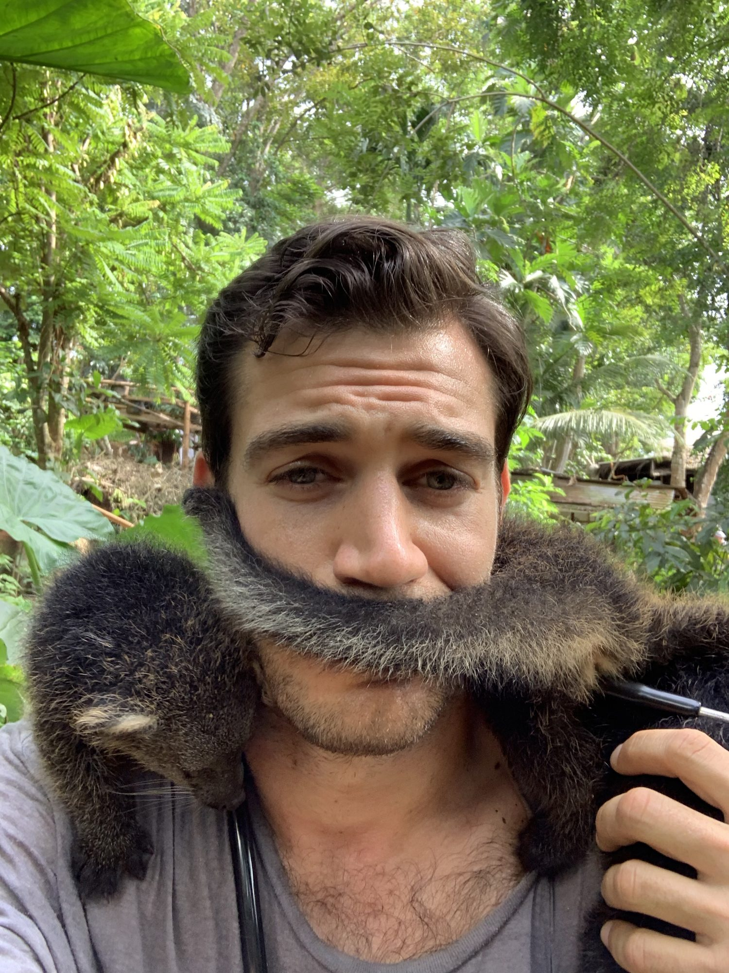 Dr. Evan Antin with bearcat tail wrapped around his face