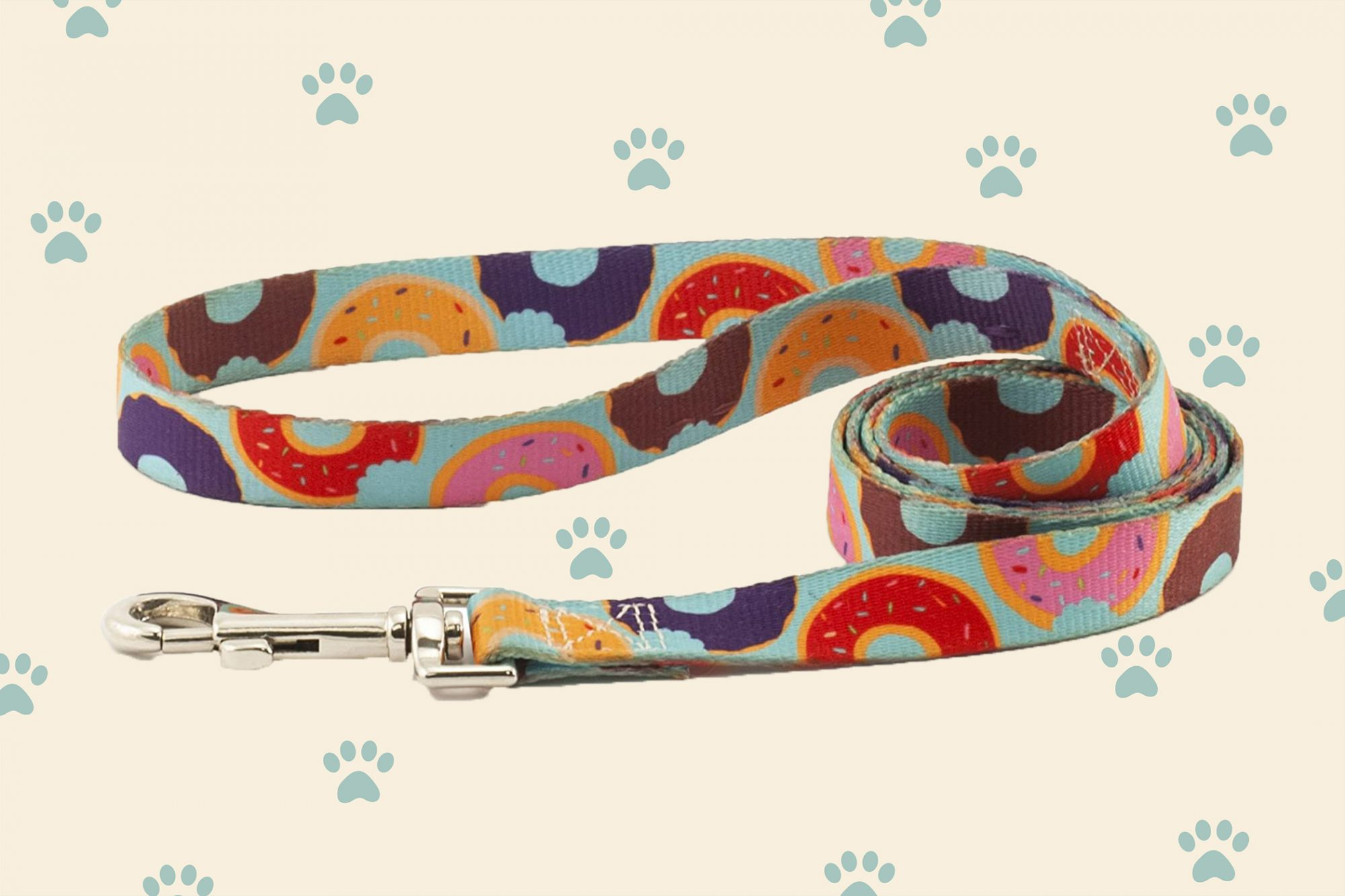 light blue dog leash with multicolored donuts design on cream background