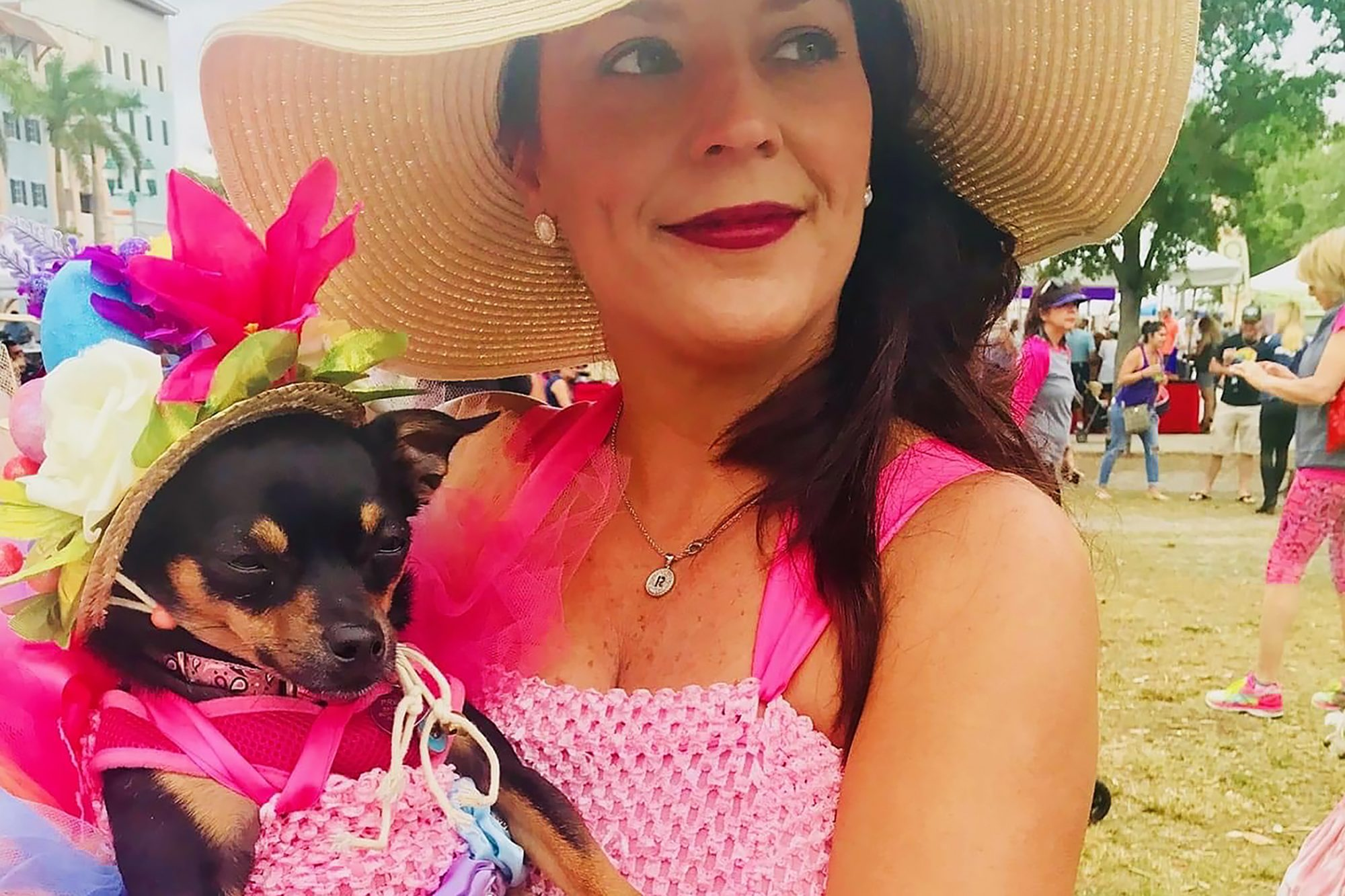 Presley the dog and owner Rebecca in matching pink outfits