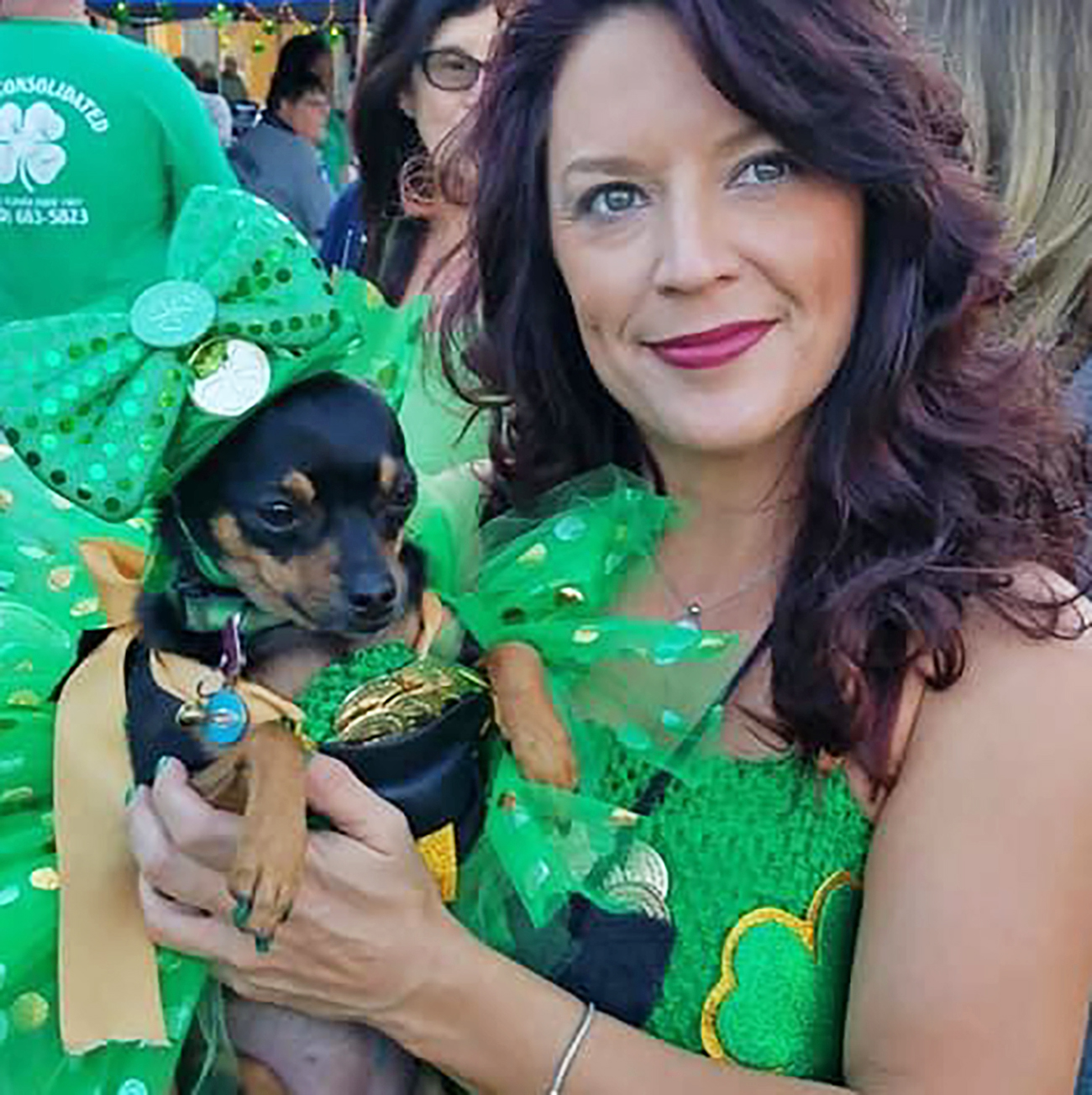 Presley the dog and owner Rebecca in St. Patrick's Day outfits