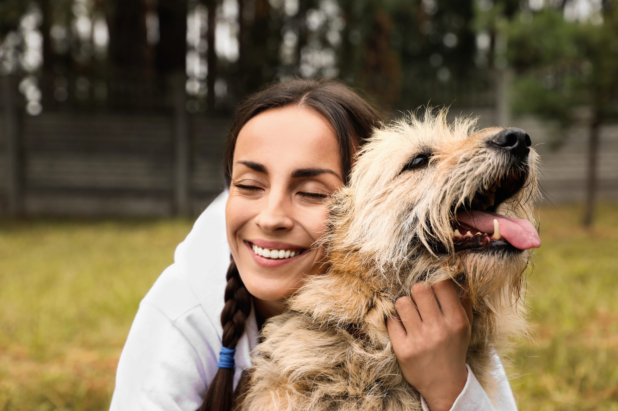 woman hugging mixed breed