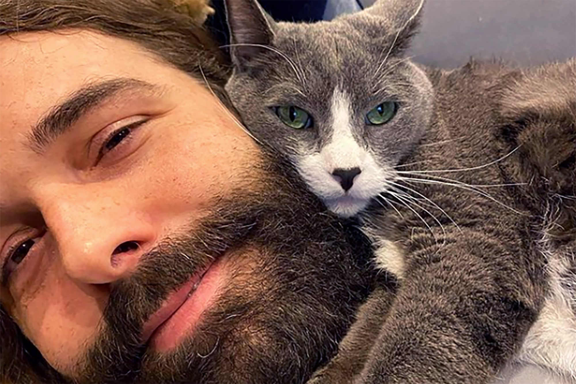 Jonathan Van Ness snuggling with grey cat