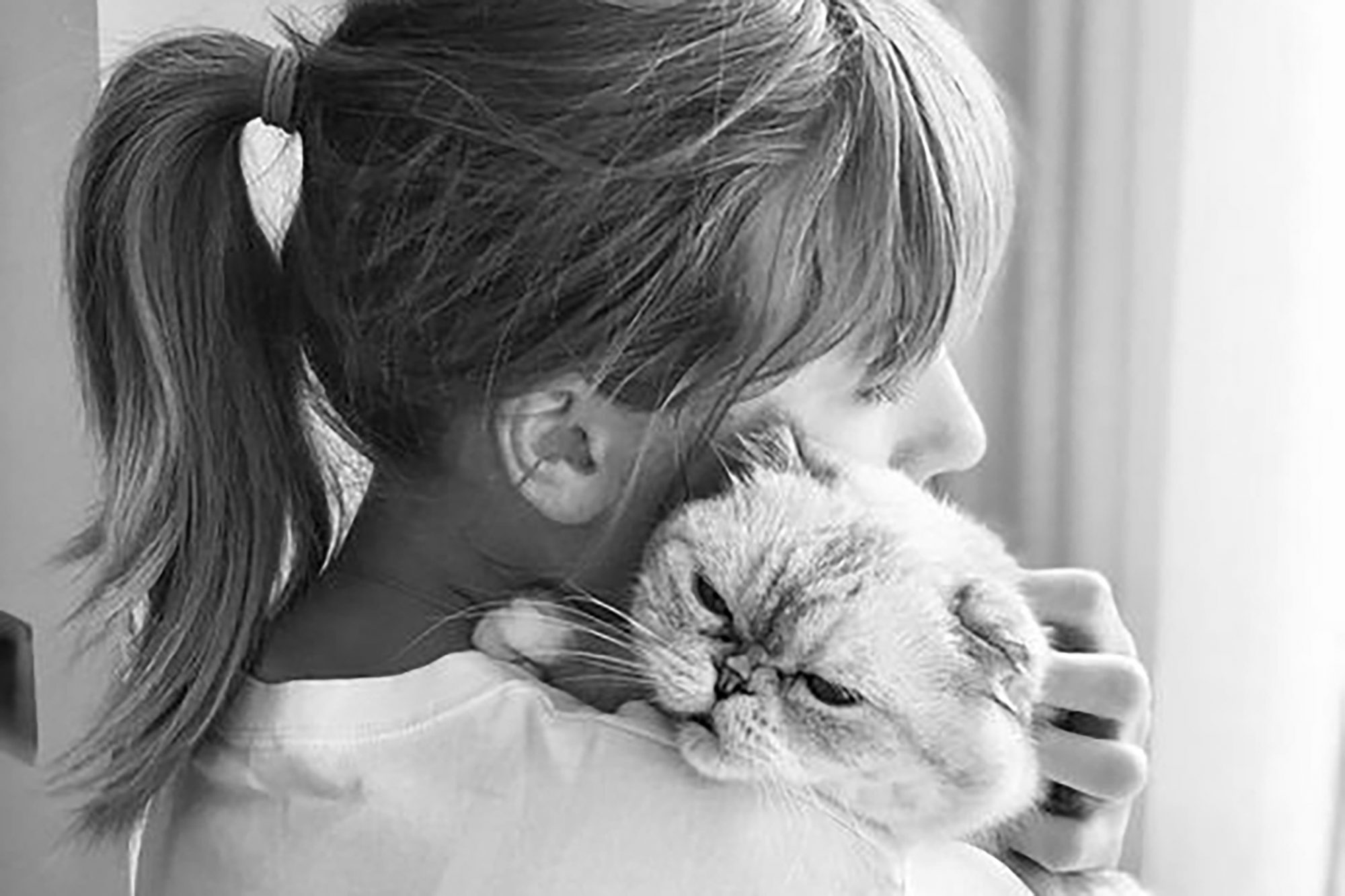 black and white image of Taylor Swift holding her cat