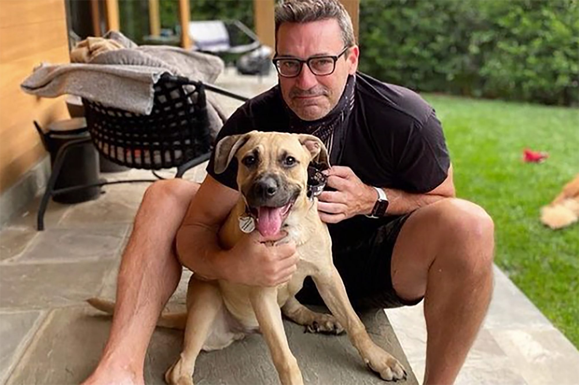Actor John Hamm embraces dog Splash