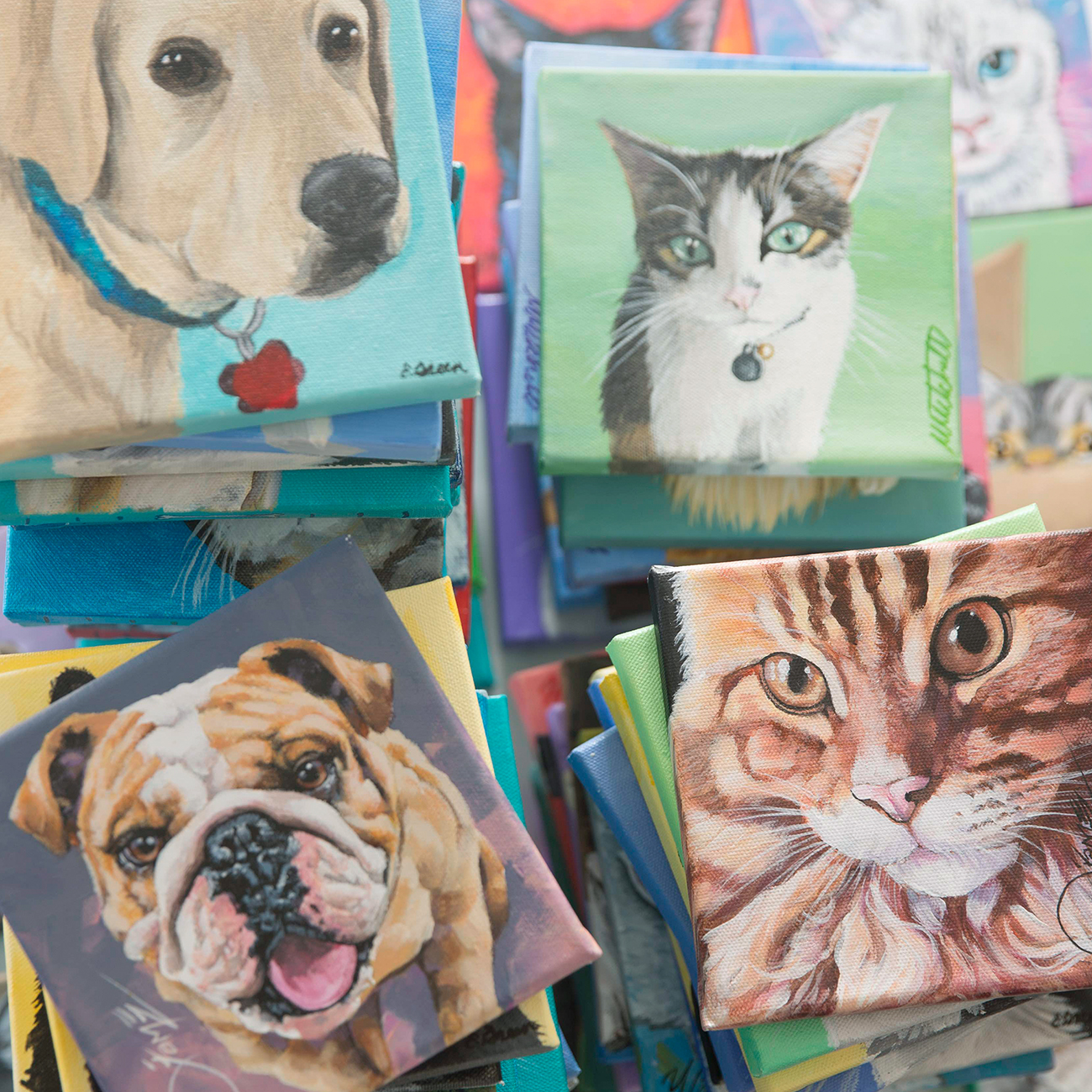 Four stacks of various painted pet portraits