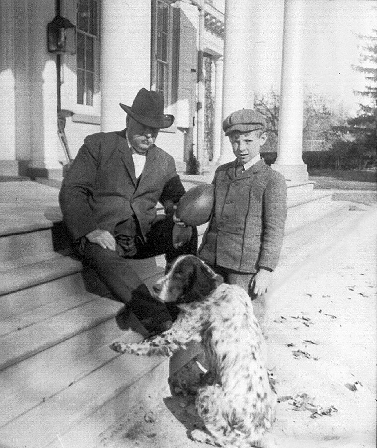 Photograph of Grover Cleveland, small boy and spotted dog